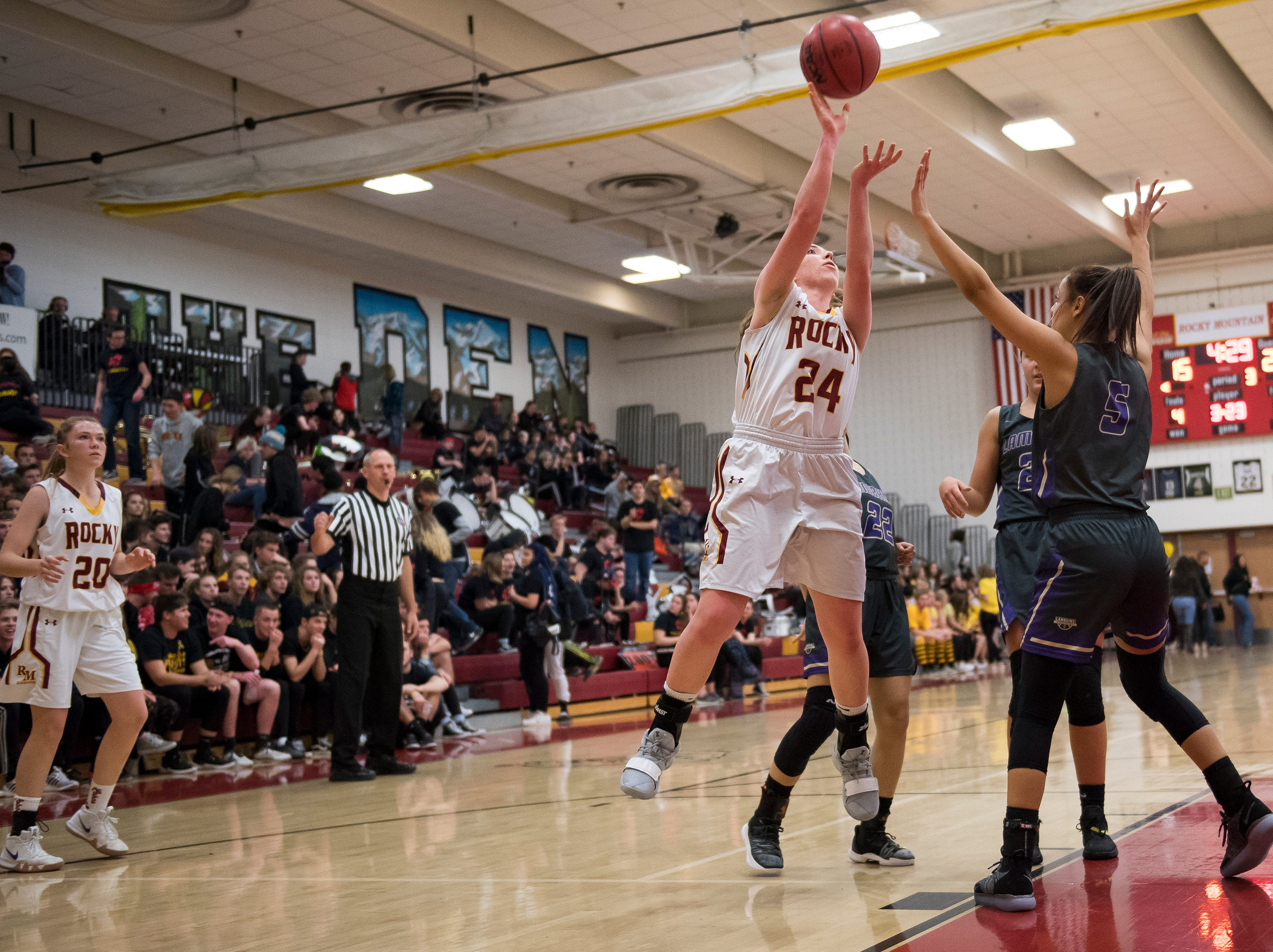 Rocky Mountain High School senior Mikayla Eccher (24) takes a shot against Fort Collins High School on Friday, Jan. 18, 2019, at Rocky Mountain High School in Fort Collins, Colo.