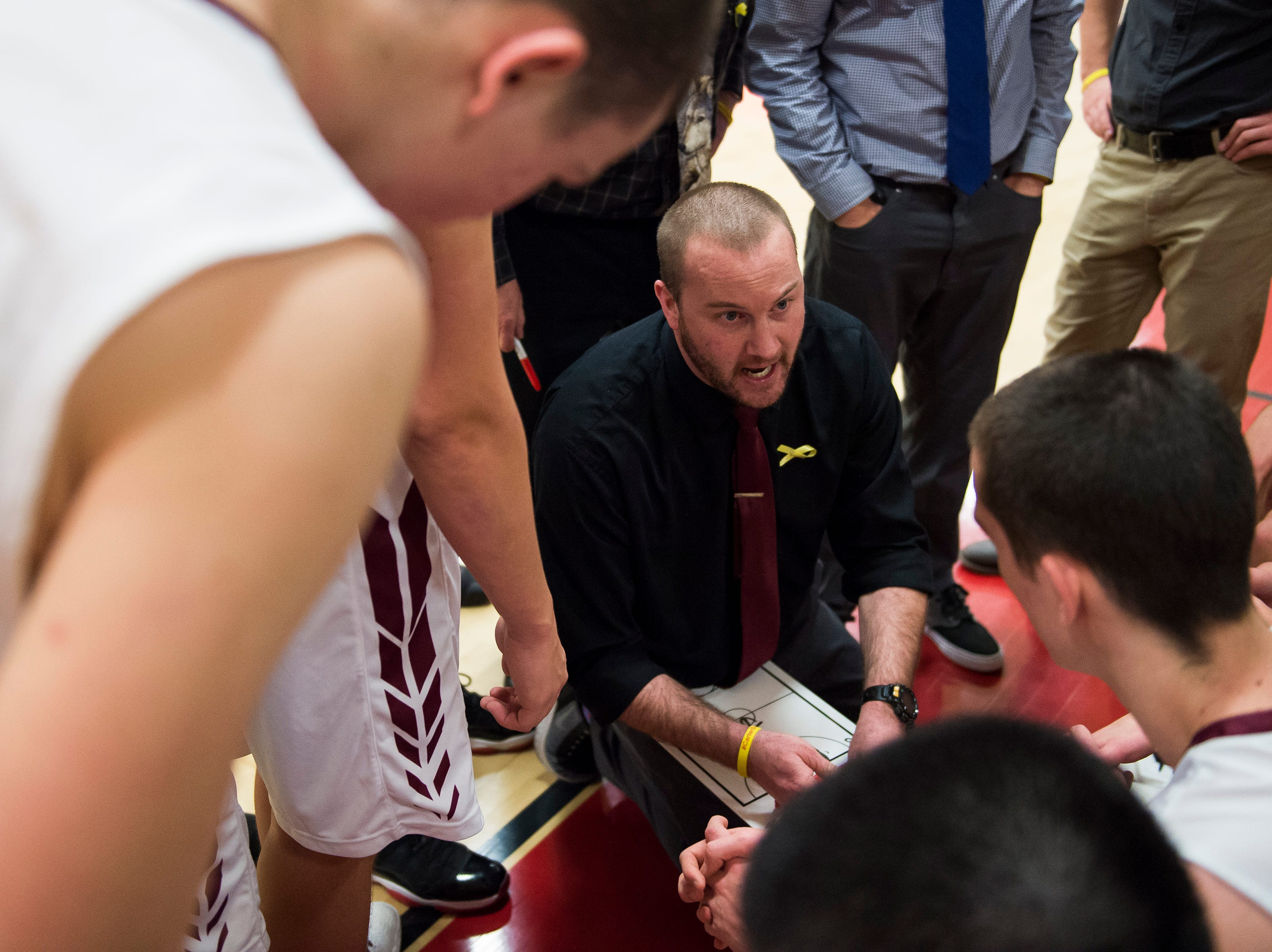 Rocky Mountain High School head boys basketball coach Brian Tafel talks to his players during a time-out in a game against Fort Collins High School on Friday, Jan. 18, 2019, at Rocky Mountain High School in Fort Collins, Colo.