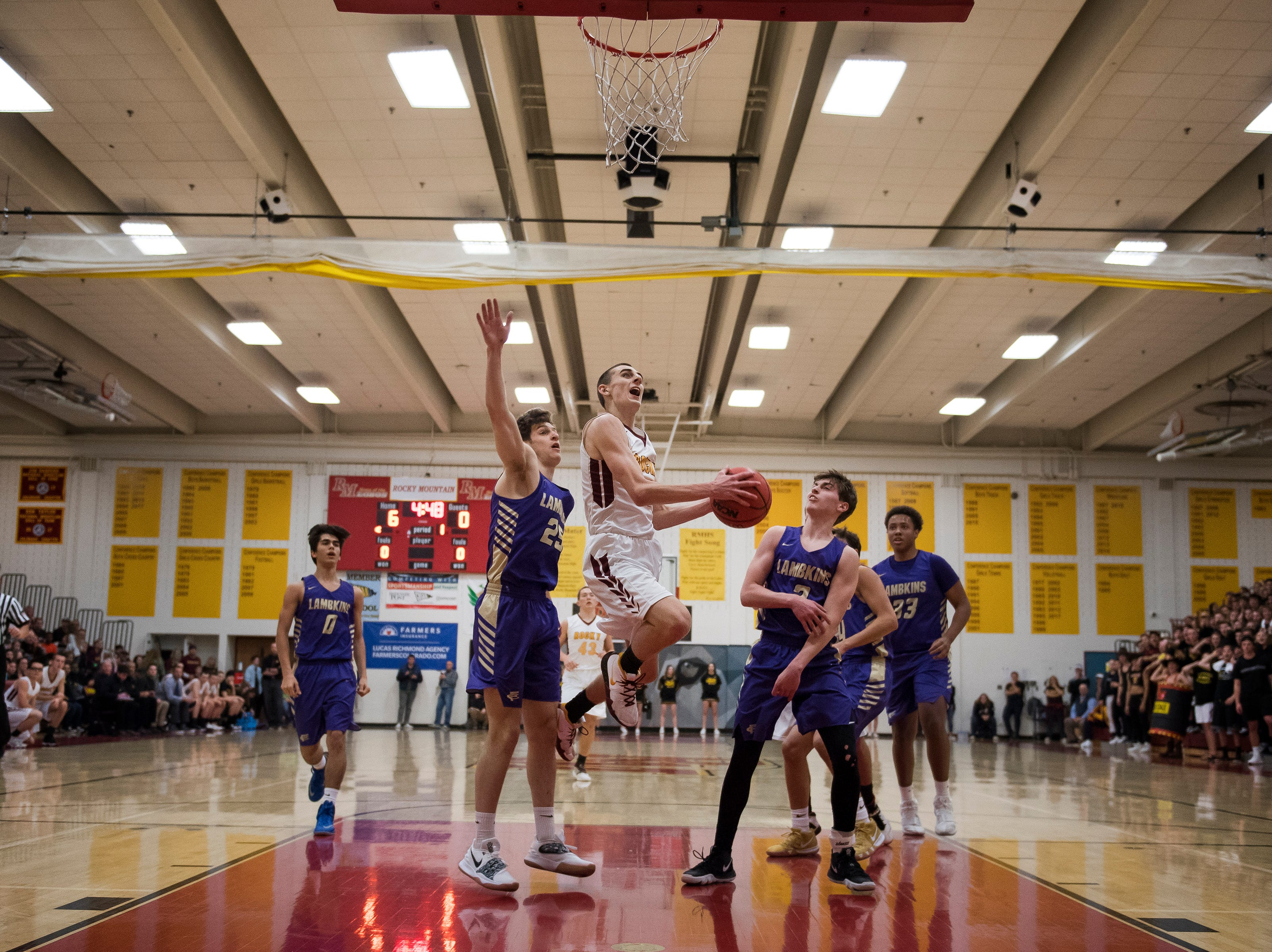 Rocky Mountain High School senior Tyler Fisher (4) puts a shot up during a game against Fort Collins High School on Friday, Jan. 18, 2019, at Rocky Mountain High School in Fort Collins, Colo.