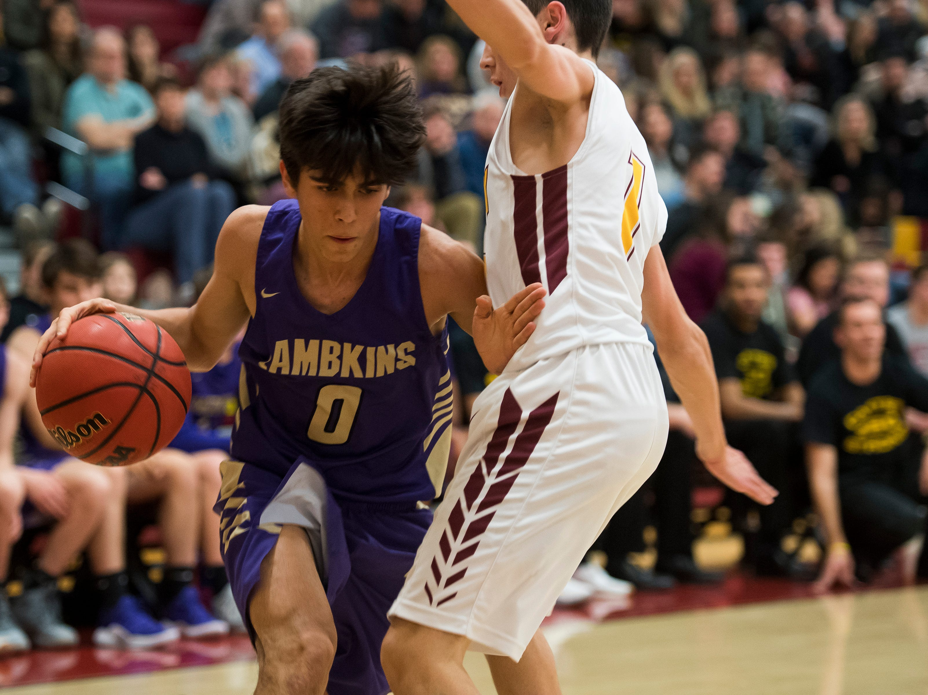 Fort Collins High School freshman Hugo Veloso (0) drives into the paint during a game against Rocky Mountain High School on Friday, Jan. 18, 2019, at Rocky Mountain High School in Fort Collins, Colo.