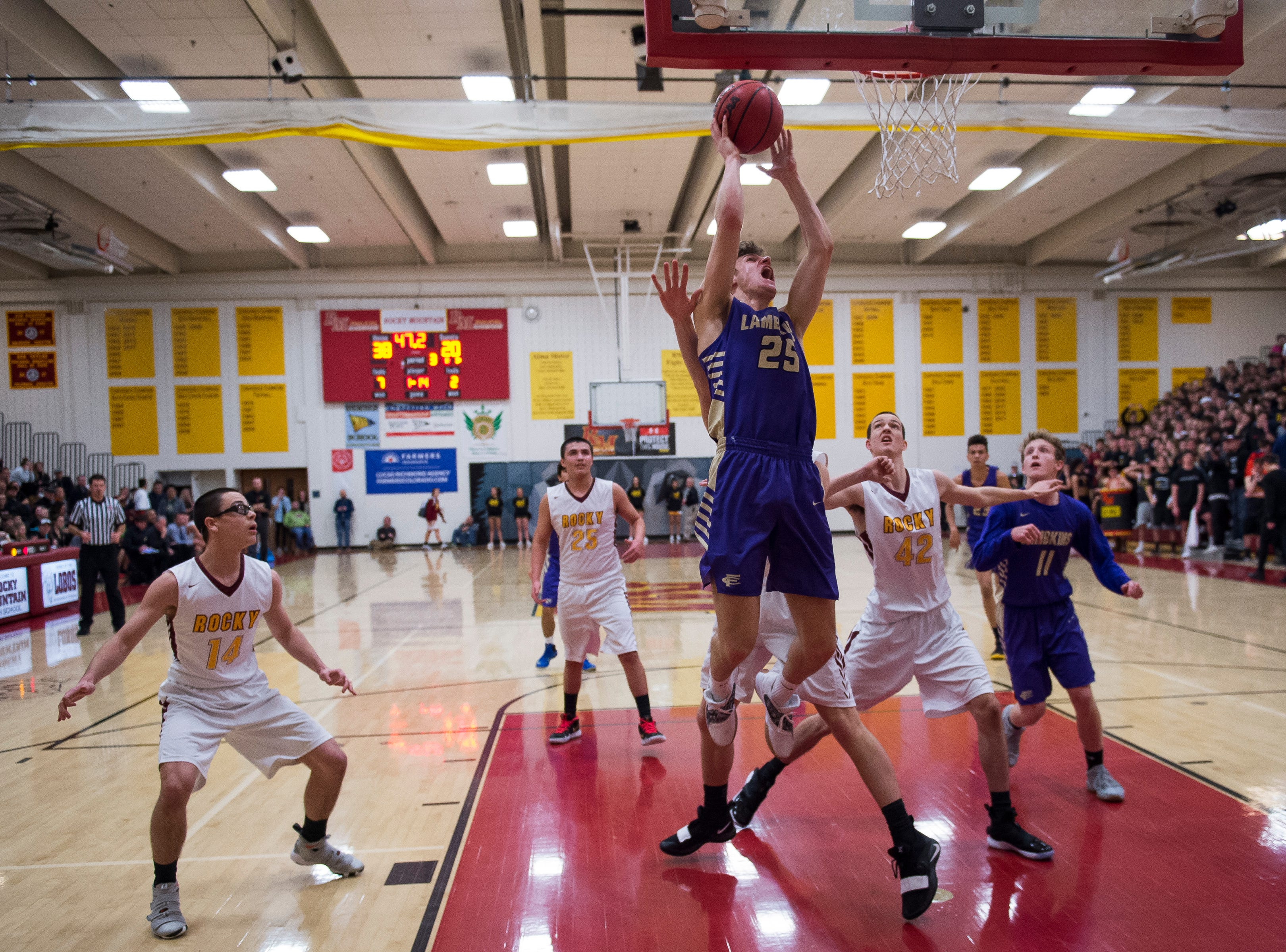 Fort Collins High School senior Benny Khouri (25) attempts a shot during a game against Rocky Mountain High School on Friday, Jan. 18, 2019, at Rocky Mountain High School in Fort Collins, Colo.