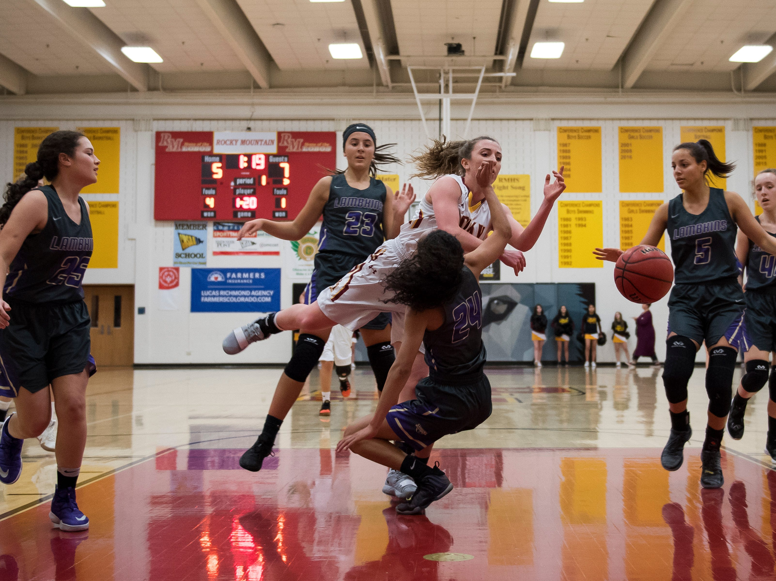 Rocky Mountain High School senior Mikayla Eccher (24) fouls out against Fort Collins High School senior Isabel Layne (24) on Friday, Jan. 18, 2019, at Rocky Mountain High School in Fort Collins, Colo.