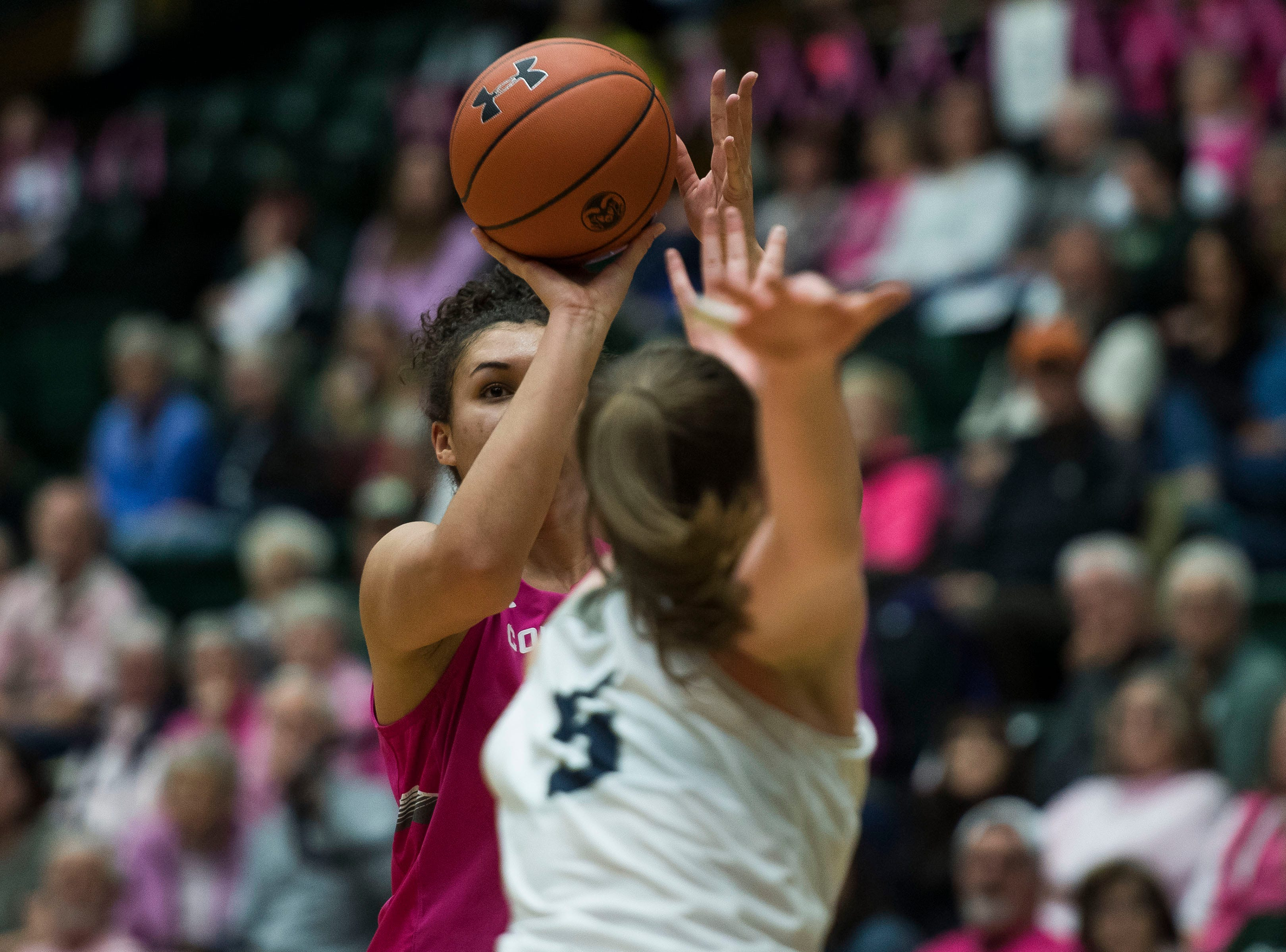 Colorado State University senior guard Myanne Hamm (21) attempts a long shot during a game against Utah State on Saturday, Jan. 19, 2019, at Moby Arena in Fort Collins, Colo.