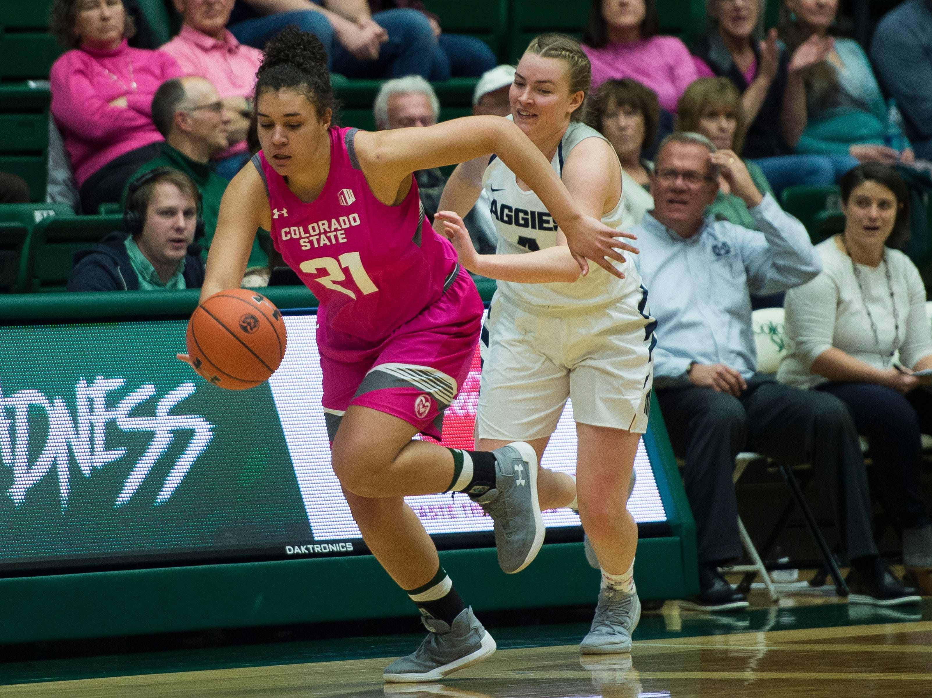Colorado State University senior guard Myanne Hamm (21) turns up-court after stealing the ball from Utah State freshman guard Steph Gorman (4) on Saturday, Jan. 19, 2019, at Moby Arena in Fort Collins, Colo.