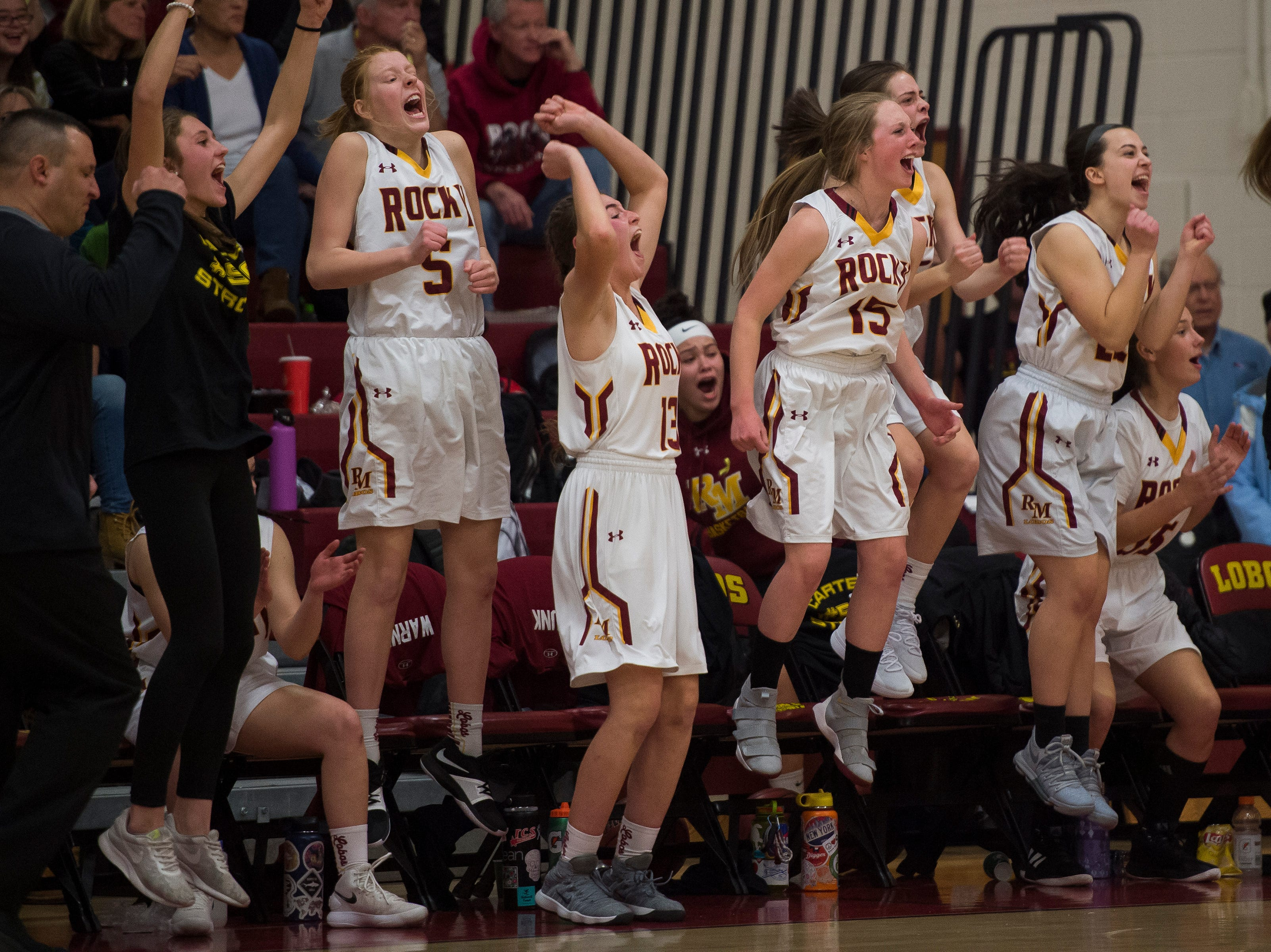 The Rocky Mountain High School bench reacts to a play in the overtime period of a game against Fort Collins High School on Friday, Jan. 18, 2019, at Rocky Mountain High School in Fort Collins, Colo.