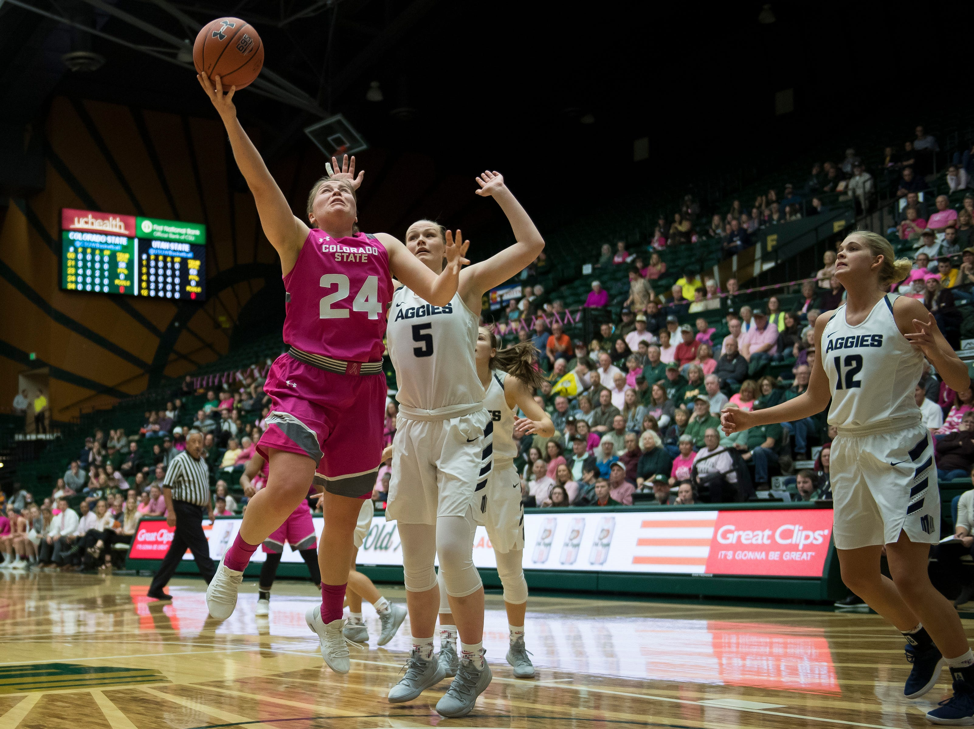 Colorado State University junior guard Mollie Mounsey (24) goes for a layup past Utah State defenders on Saturday, Jan. 19, 2019, at Moby Arena in Fort Collins, Colo.