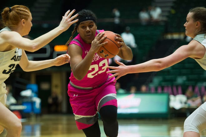 Guard Grace Colaivalu, shown driving through Utah State defenders during a Jan. 19 game at Moby Arena, and her teammates on the CSU women's basketball team will play a road game at 7 p.m. Wednesday at Boise State.