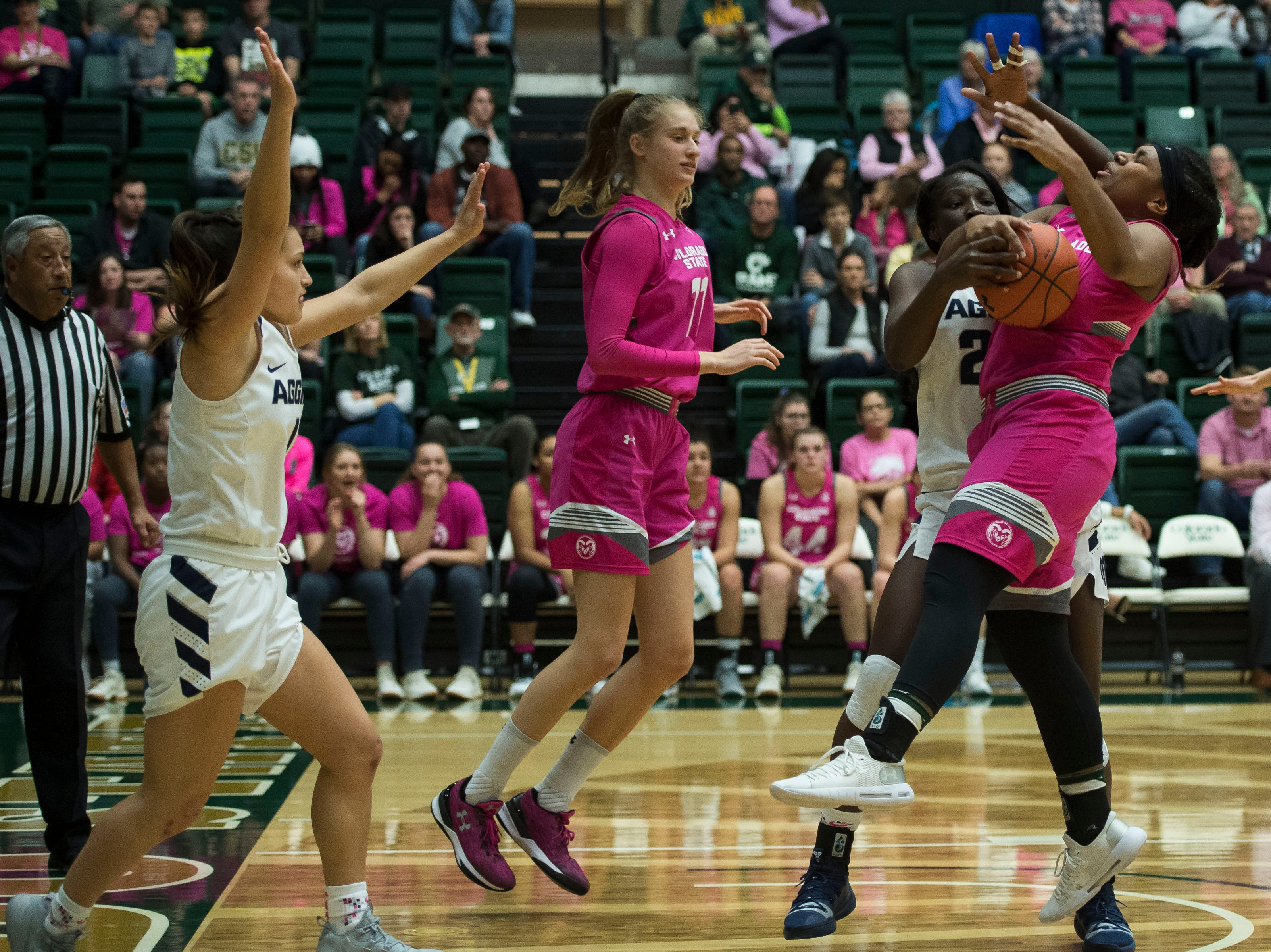 Colorado State University sophomore guard Grace Colaivalu (23) has the ball knocked out by Utah State junior forward Marlene Aniambossou (24) on Saturday, Jan. 19, 2019, at Moby Arena in Fort Collins, Colo.