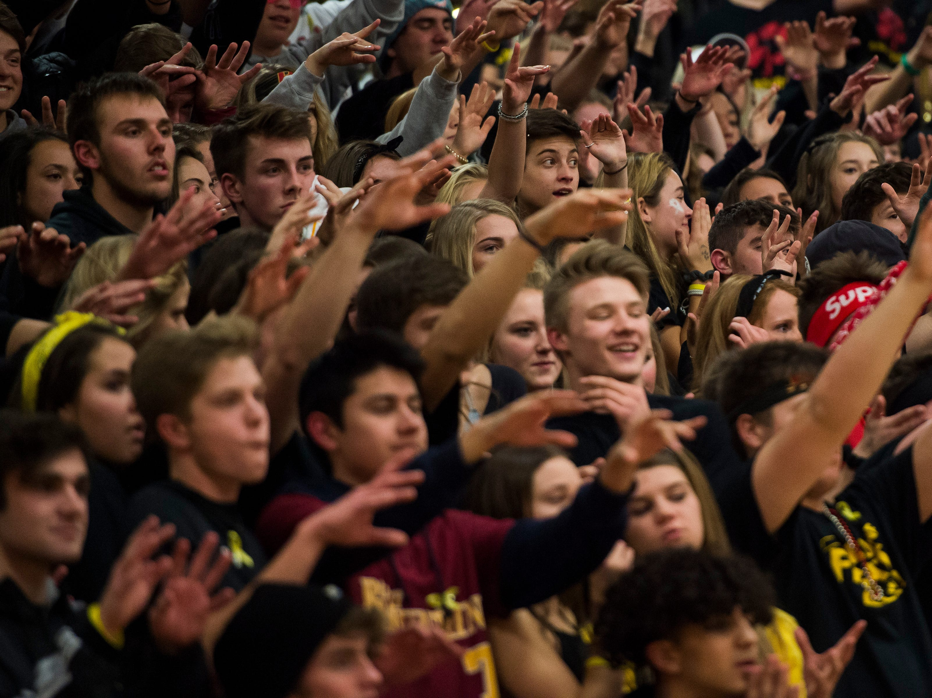 The Rocky Mountain High School student section gives good vibes while a player attempts a free throw during a game against Fort Collins High School on Friday, Jan. 18, 2019, at Rocky Mountain High School in Fort Collins, Colo.