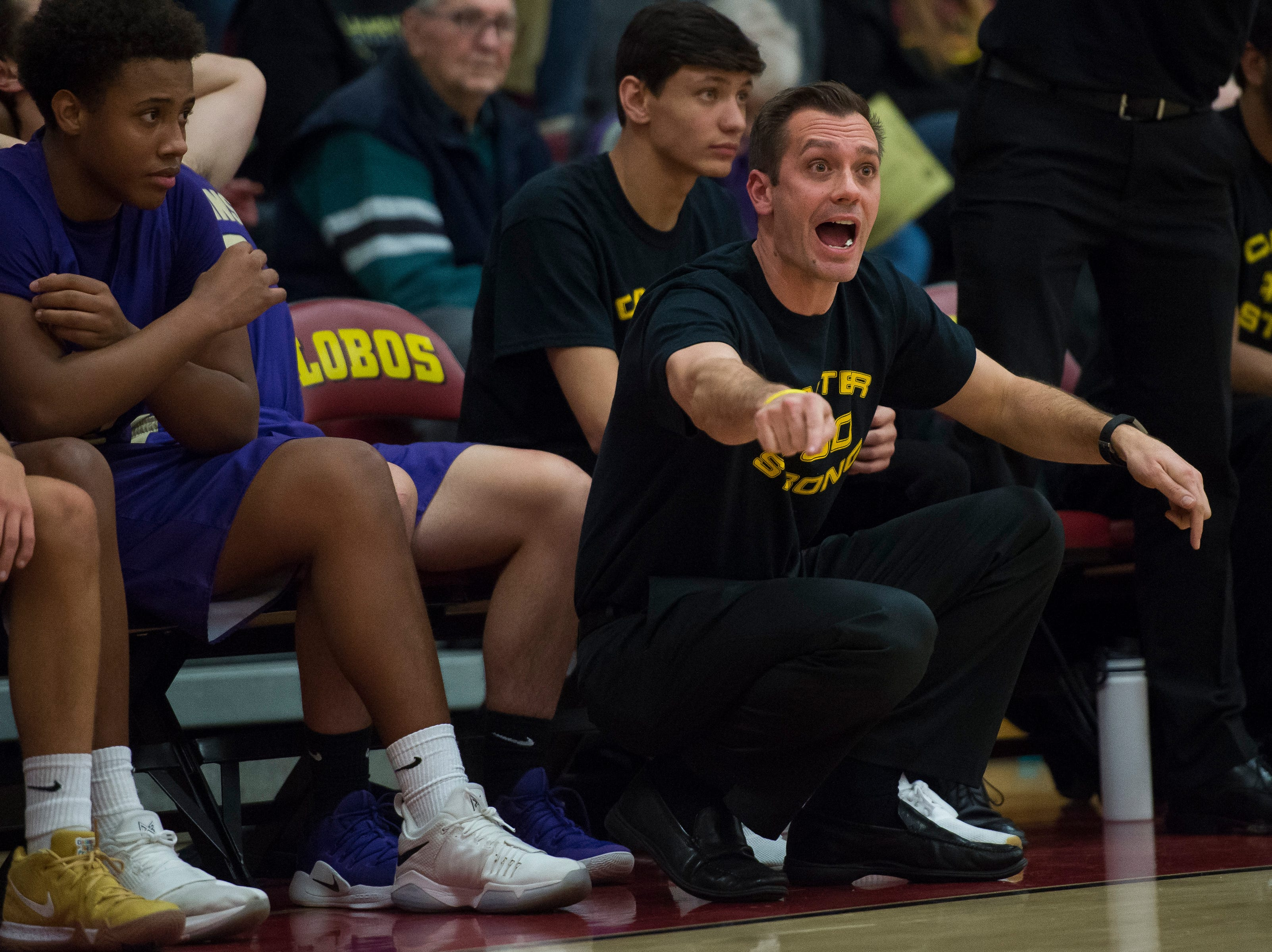 Fort Collins High School head basketball coach Jeff Schmidt talks to his players during a game against Rocky Mountain High School on Friday, Jan. 18, 2019, at Rocky Mountain High School in Fort Collins, Colo.