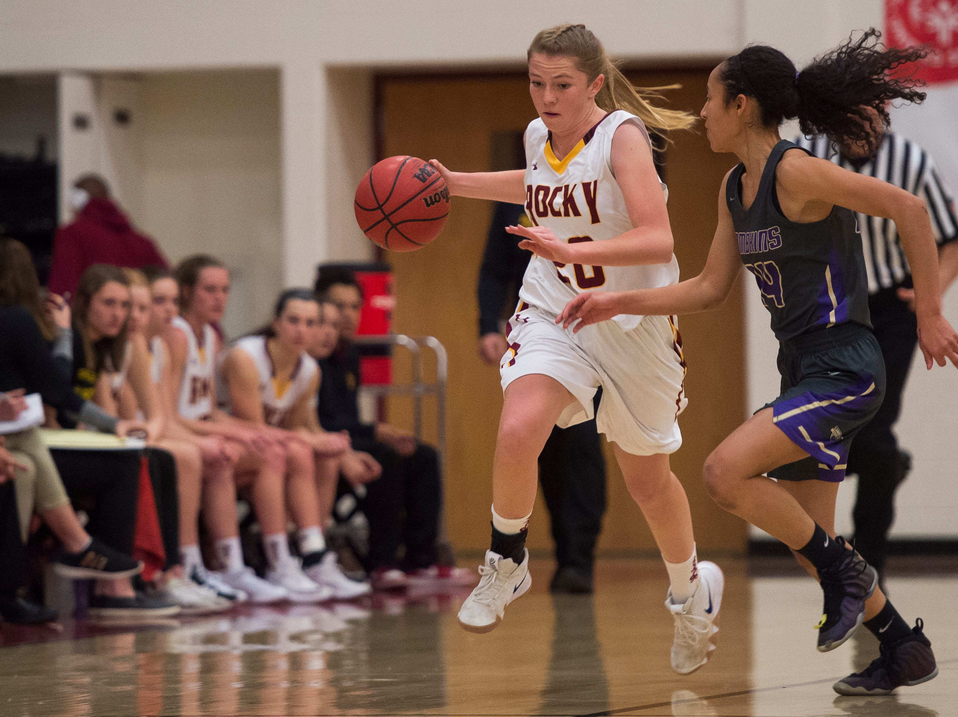 Rocky Mountain High School senior Madison Hand (20) drives downcourt against Fort Collins High School Isabel Layne (24) on Friday, Jan. 18, 2019, at Rocky Mountain High School in Fort Collins, Colo.