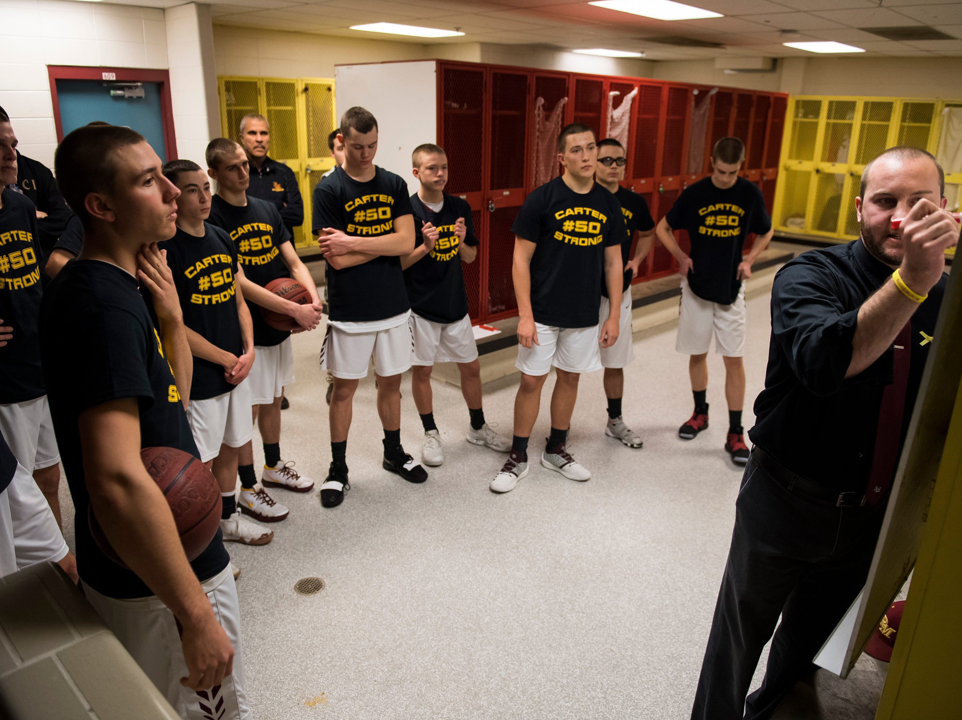 Rocky Mountain High School head boys basketball coach Brian Tafel strategizes while his players in h locker room before a game against Fort Collins High School on Friday, Jan. 18, 2019, at Rocky Mountain High School in Fort Collins, Colo.