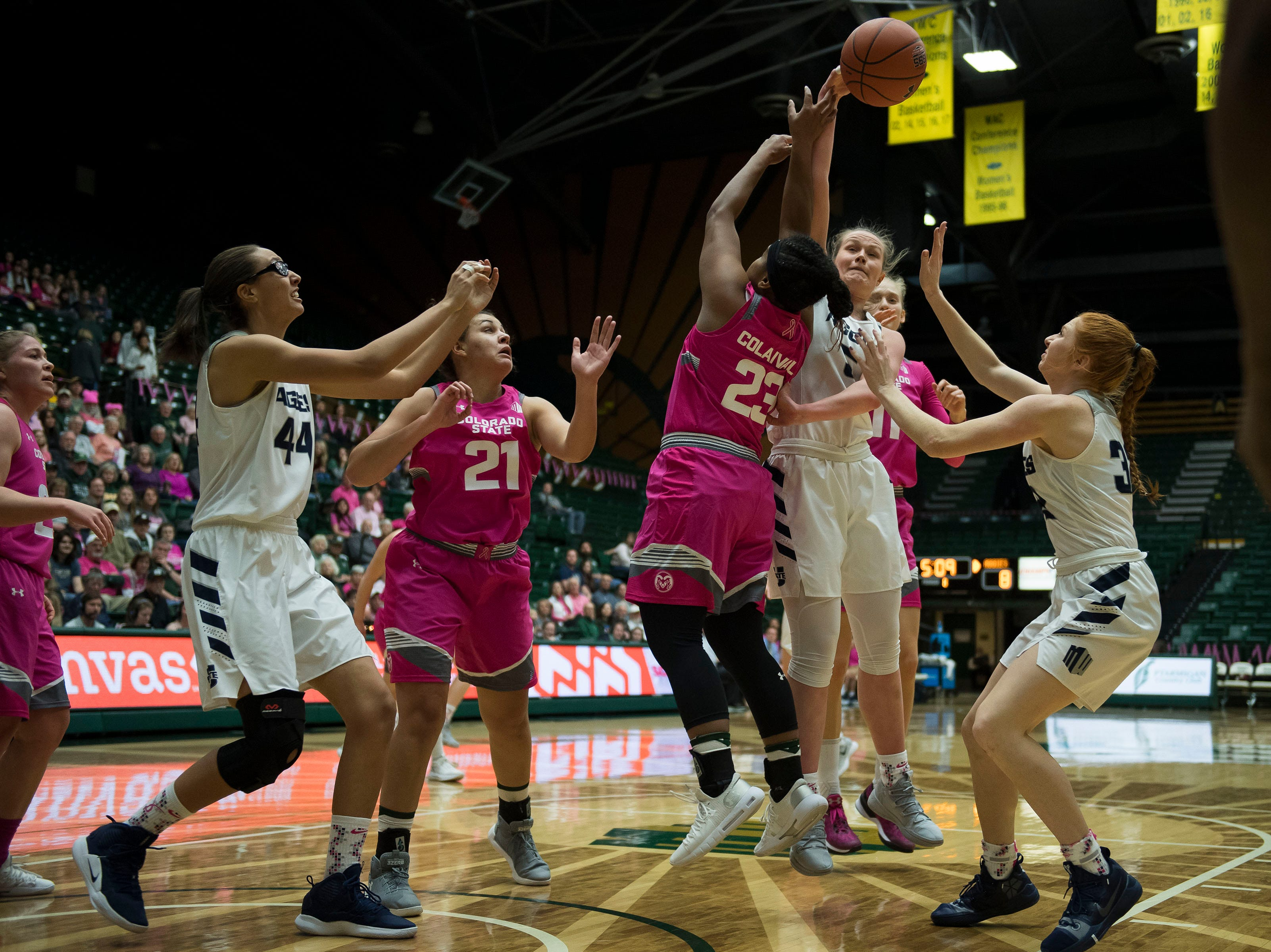 Utah State junior forward Shannon Dufficy (5) knocks down a rebound during a game against Colorado State University on Saturday, Jan. 19, 2019, at Moby Arena in Fort Collins, Colo.