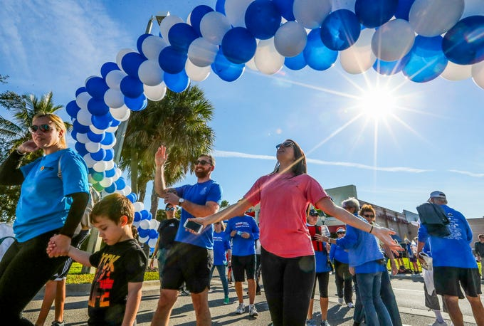 Krista Koppenberger, of Estero, and Harlen Lawrence, Fort Myers, walk under the balloon arch at the end of their walk. The 11th annual WINK Feeds Family hunger walk that supports the Harry Chapin Food Bank of Southwest Florida went off Saturday, January 19, 2019. The walk was held at Miromar Outlets in Estero, FL, and they did a 2 mile walk around the mall. The Hunger Walk raises a preliminary $212,000 for the Harry Chapin Food Bank.