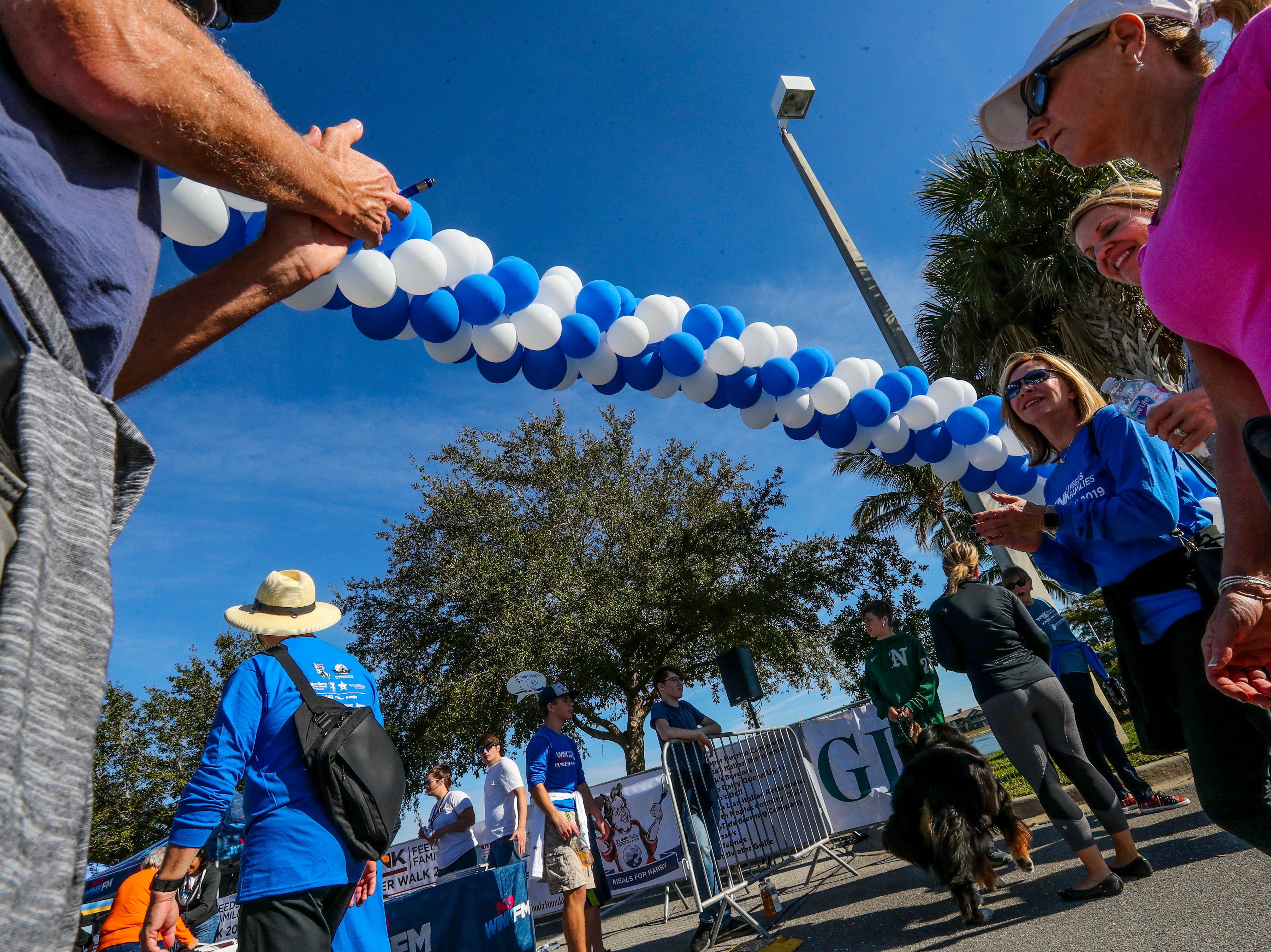 Jon Cohn, a walk volunteer, greets the walkers with a cheer as he encourages them at the end of the race. The 11th annual WINK Feeds Family hunger walk that supports the Harry Chapin Food Bank of Southwest Florida went off Saturday, January 19, 2019. The walk was held at Miromar Outlets in Estero, FL, and they did a 2 mile walk around the mall.