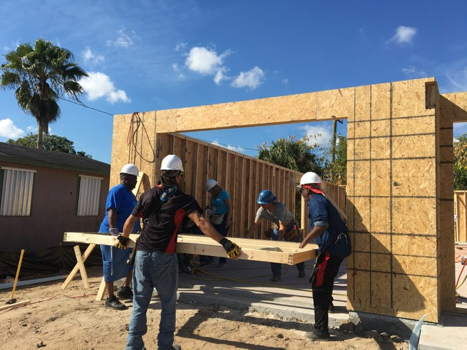 Volunteers work to raise the walls of one of two Habitat for Humanity homes Saturday, Jan. 19, 2019 in Fort Myers as part of the Beloved Community initiative inspired by Dr. Martin Luther King, Jr.