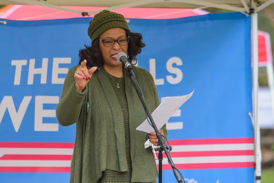 Lillian Brock Flemming speaks the the gathered crowd at the 2019 Greenville Women's March in Greenville's Falls Park on Saturday, January 19, 2019.
