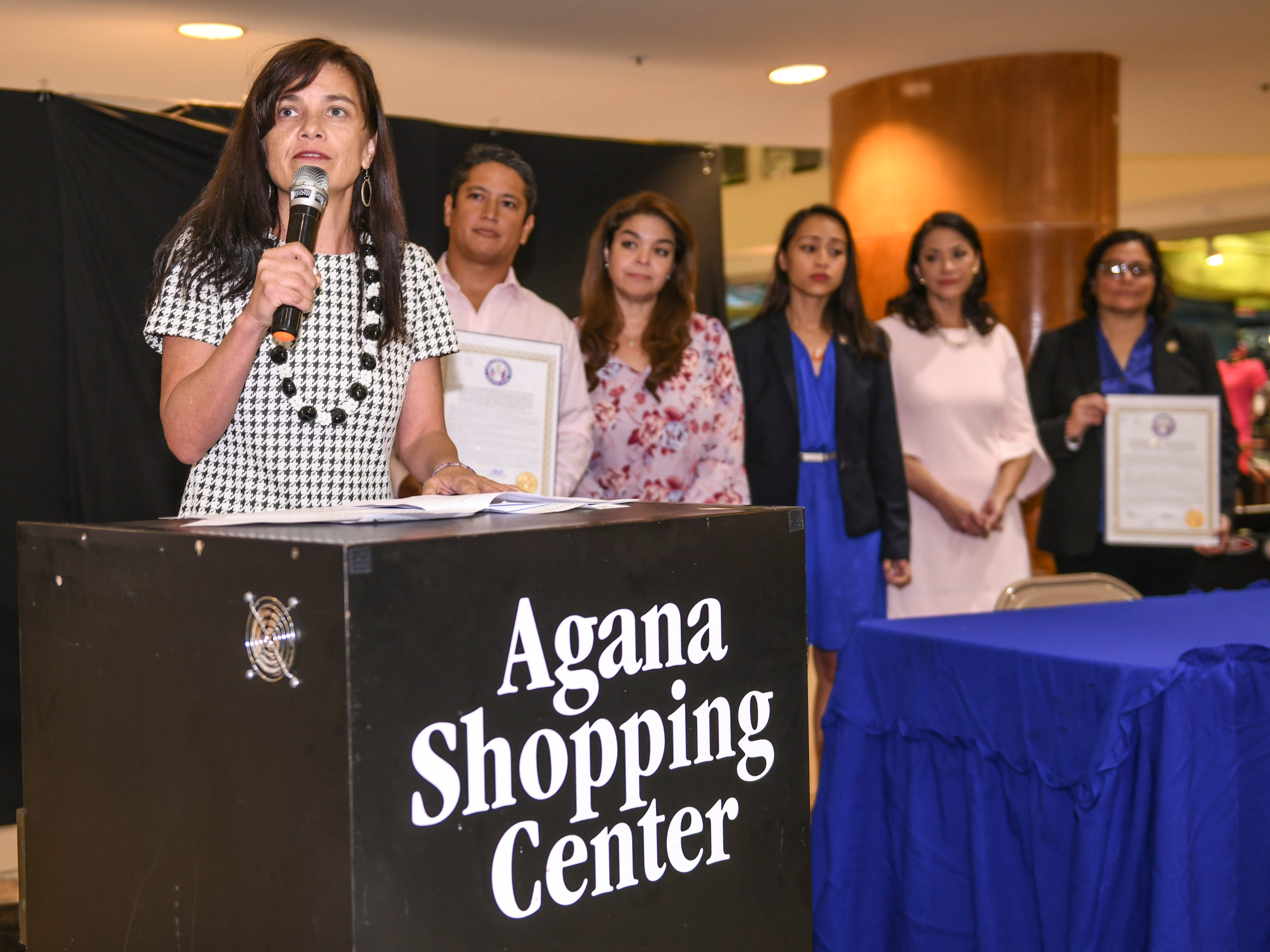 Sen. Therese Terlaje and other members of the 35th Guam Legislature prepare to present two resolutions, in support and appreciation of advocates working to alleviate incidences of violence, during the National Slavery and Human Trafficking Prevention Month and National Stalking Awareness Month Outreach Fair at the Agana Shopping Center on Saturday, Jan. 19, 2019.