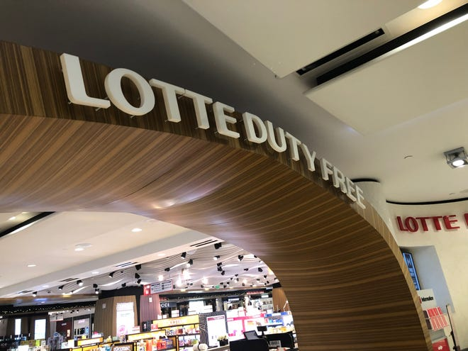 A Lotte Duty Free sign in the A.B. Won Pat International Airport.