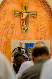 Archbishop Michael Byrnes delivers his keynote address to the participants of Guam Catholic Men's Conference held at Father Duenas Memorial School Boy's Chapel on Jan. 19.