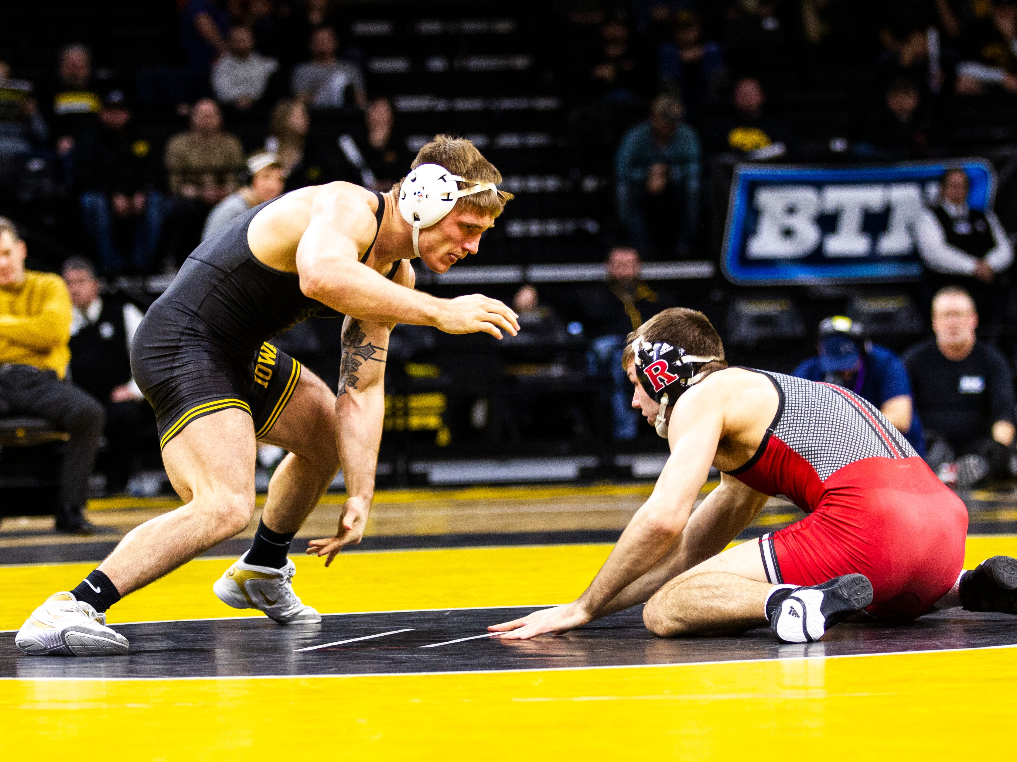 Iowa's Cash Wilcke, left, wrestles Rutgers' Willie Scott at 184 during a NCAA Big Ten Conference wrestling dual on Friday, Jan. 18, 2019, at Carver-Hawkeye Arena in Iowa City, Iowa.