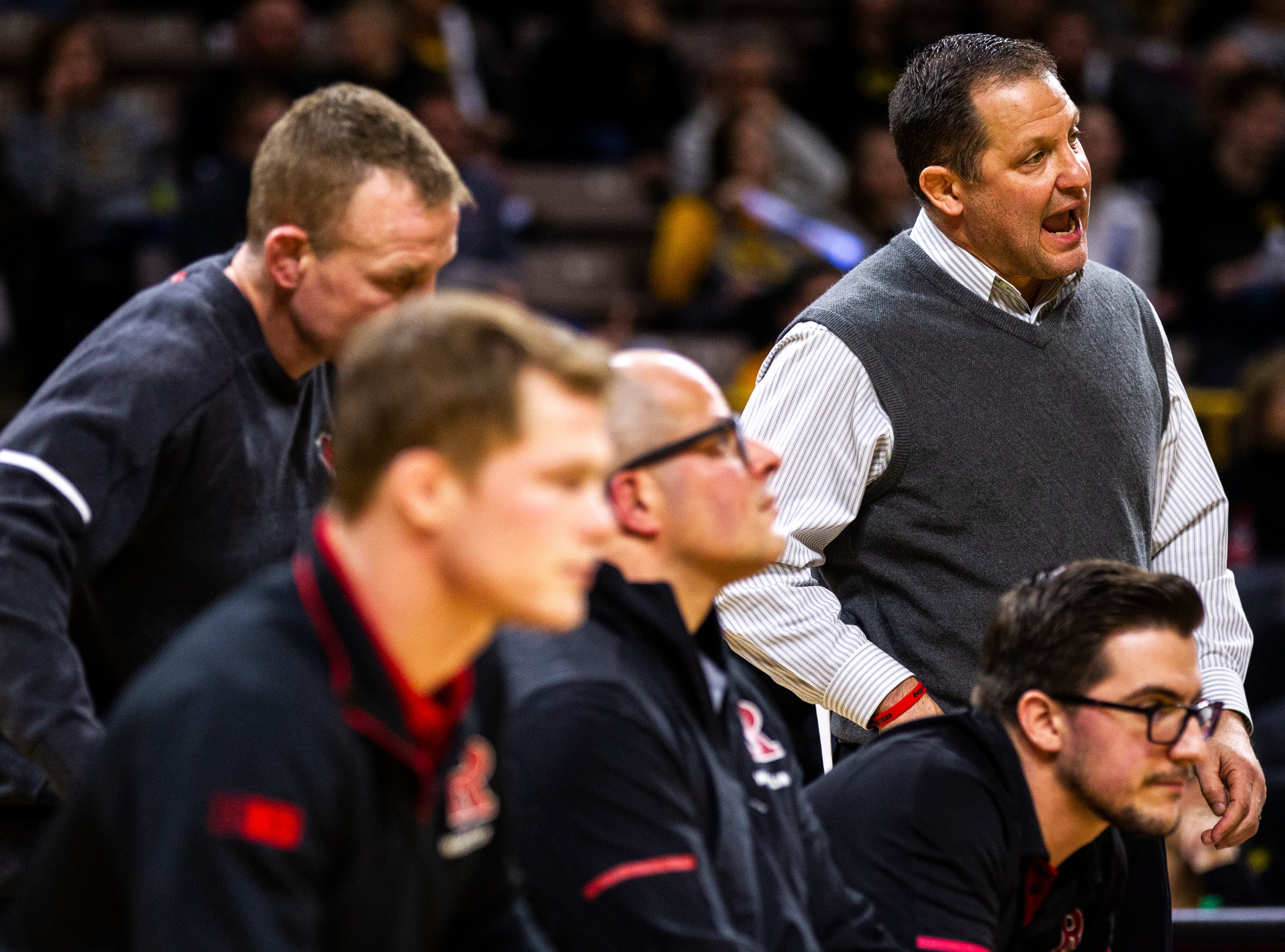 Rutgers head coach Scott Goodale, far right, calls out during a NCAA Big Ten Conference wrestling dual on Friday, Jan. 18, 2019, at Carver-Hawkeye Arena in Iowa City, Iowa.
