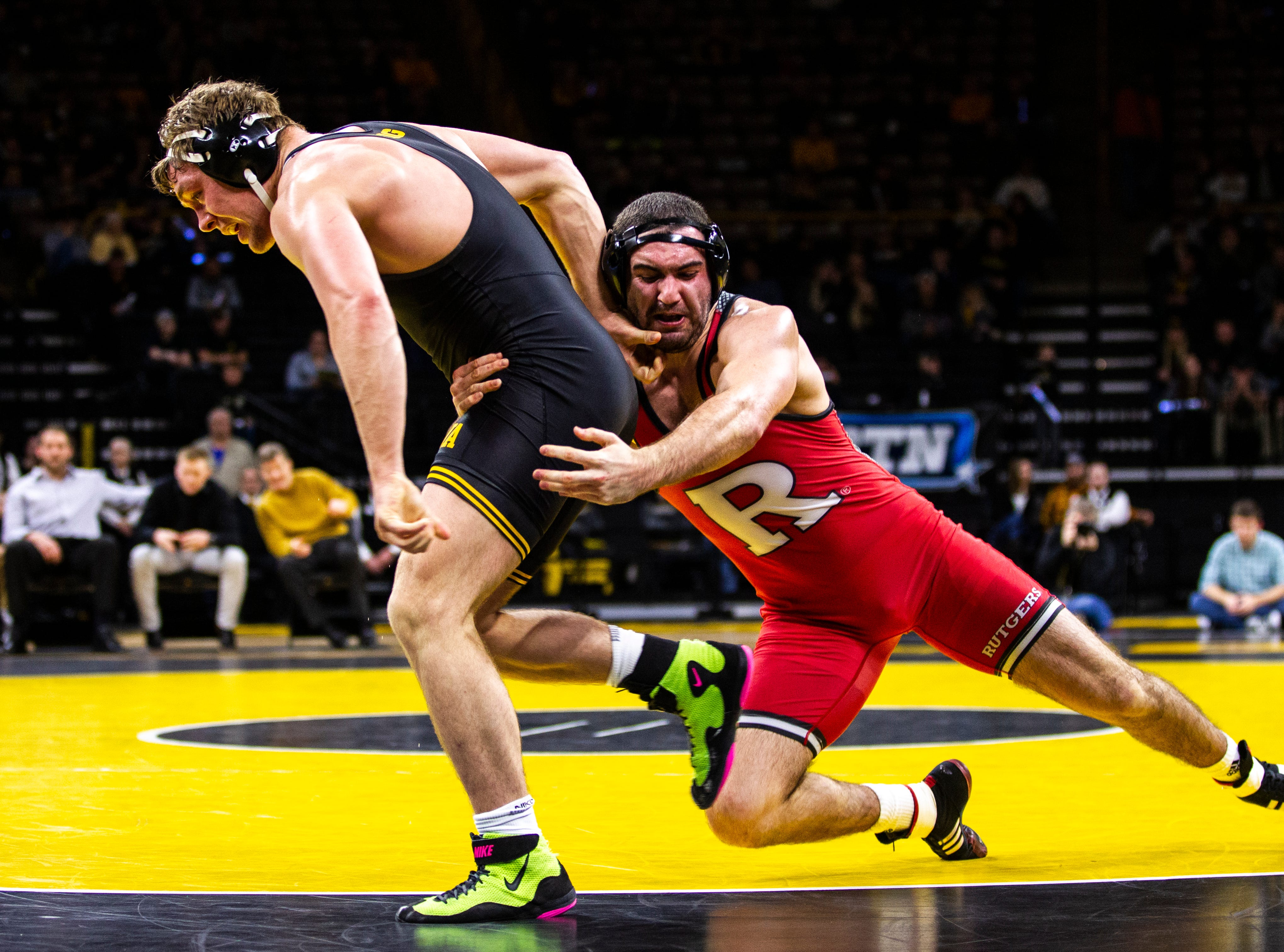 Rutgers' Matthew Correnti, right, wrestles Iowa's Jacob Warner at 197 during a NCAA Big Ten Conference wrestling dual on Friday, Jan. 18, 2019, at Carver-Hawkeye Arena in Iowa City, Iowa.
