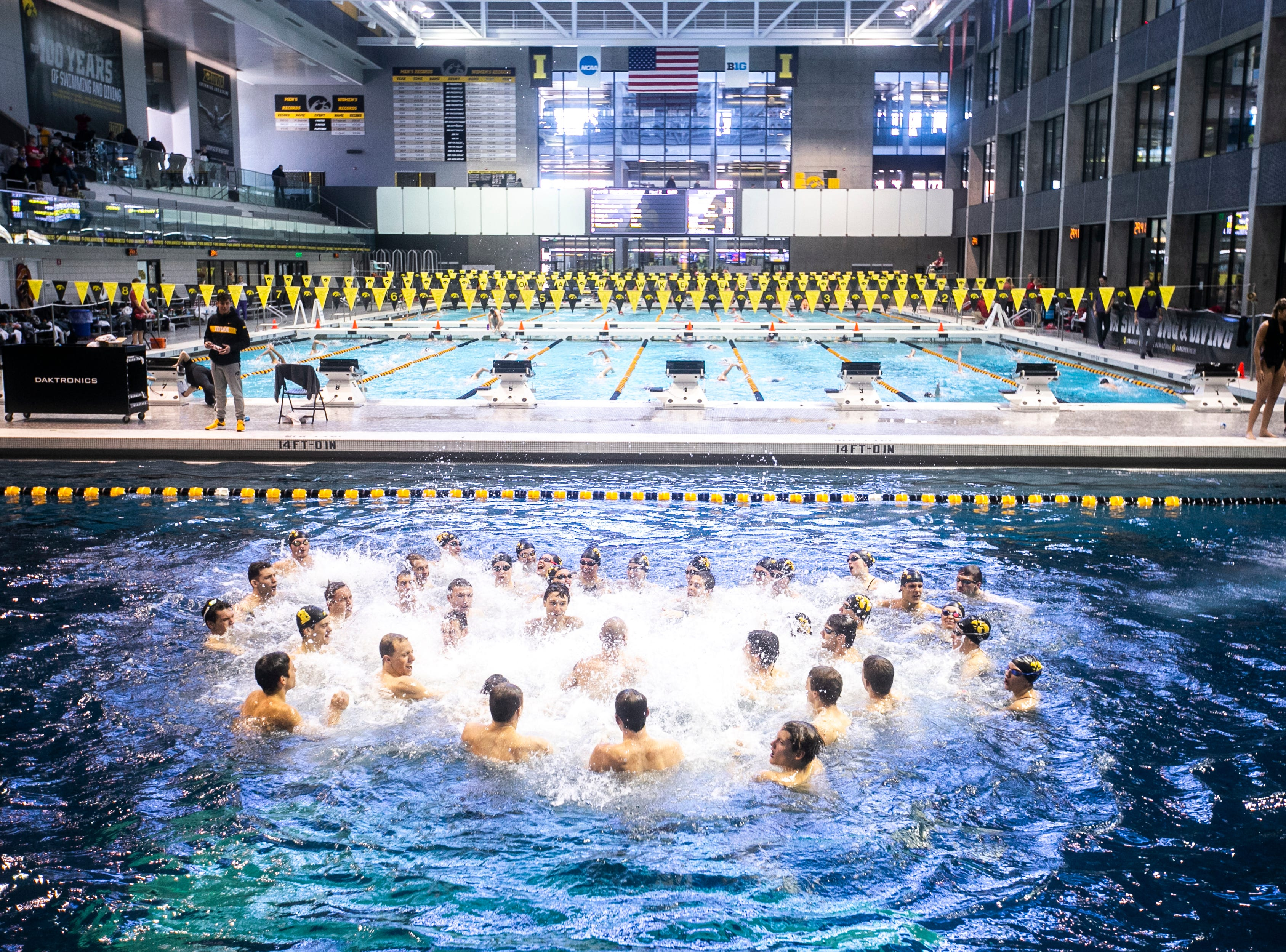 Iowa Hawkeyes celebrate in the diving pool after a NCAA Big Ten Conference swimming meet on Saturday, Jan. 19, 2019, at the Campus Recreation and Wellness Center in Iowa City, Iowa.