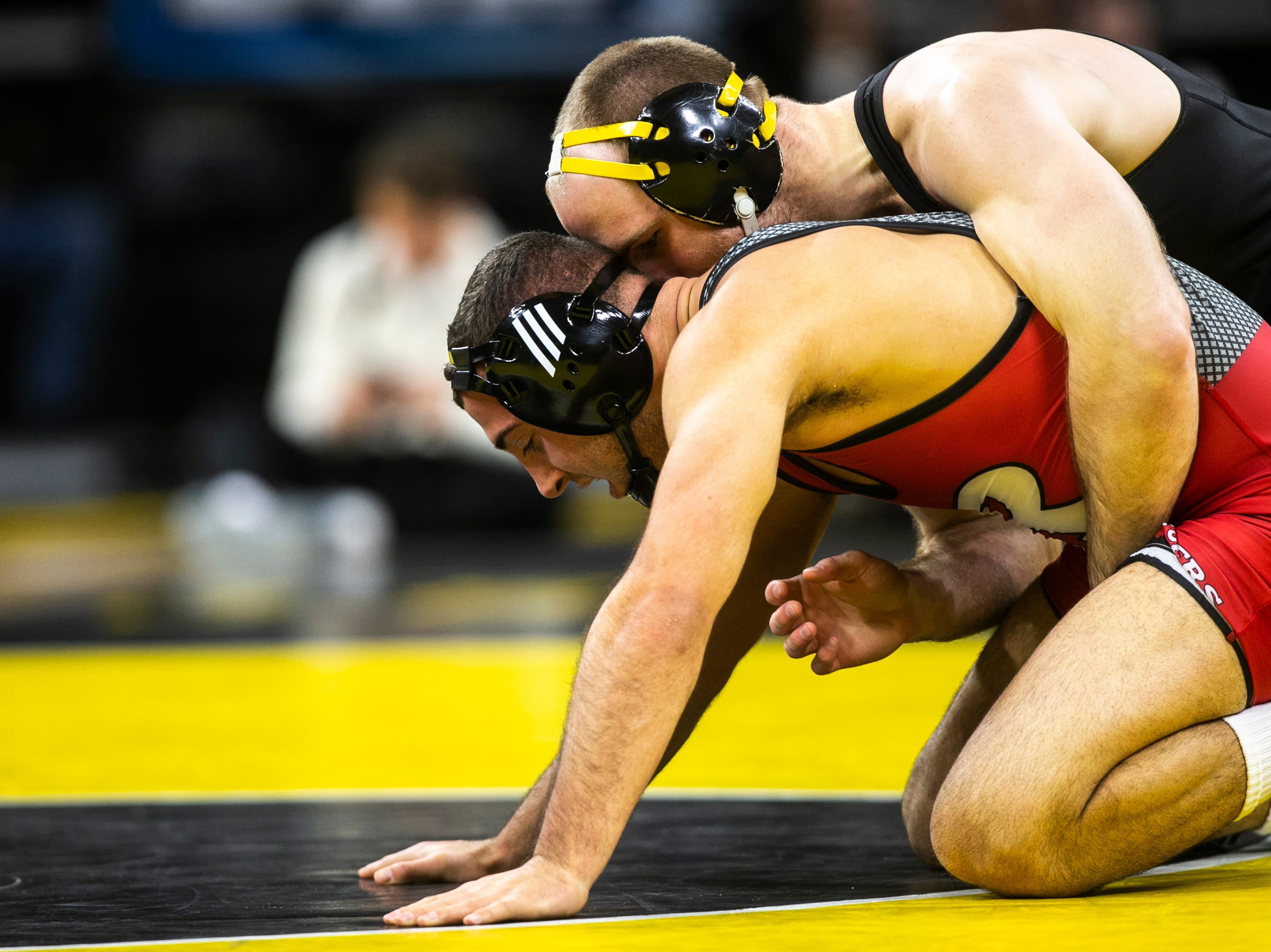 Iowa's Alex Marinelli, top, wrestles Rutgers' Anthony Oliveri at 165 during a NCAA Big Ten Conference wrestling dual on Friday, Jan. 18, 2019, at Carver-Hawkeye Arena in Iowa City, Iowa.
