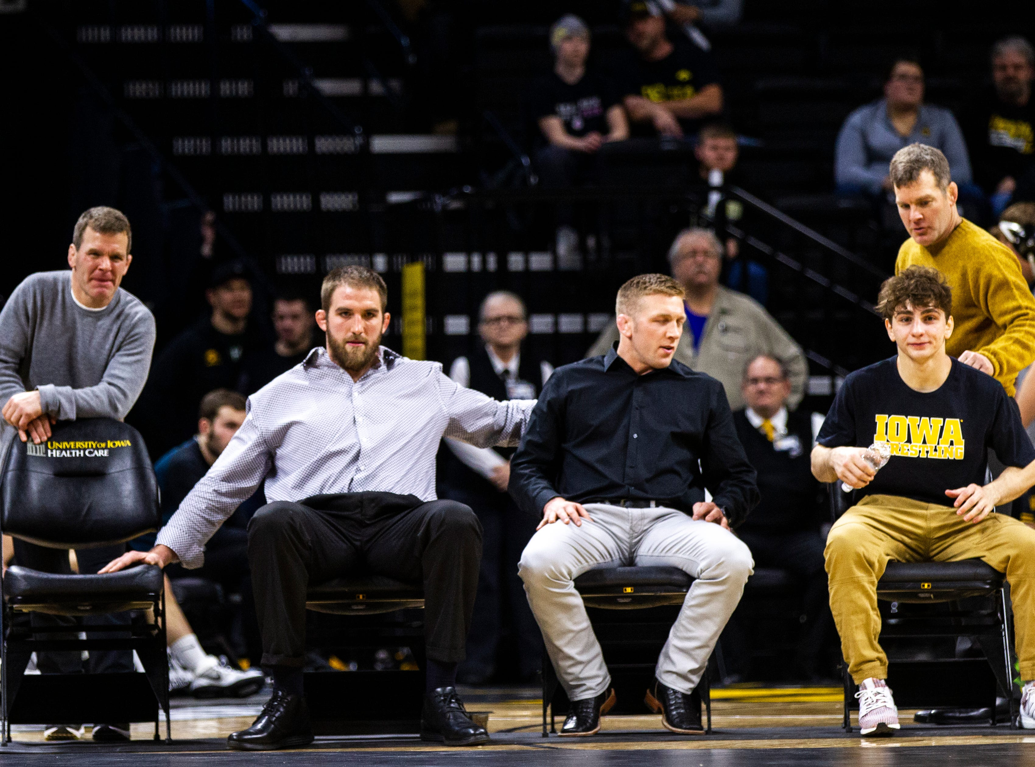 Iowa's Terry Brands, Bobby Telford, Ryan Morningstar and Tom Brands invite Austin DeSanto to the bench during a NCAA Big Ten Conference wrestling dual on Friday, Jan. 18, 2019, at Carver-Hawkeye Arena in Iowa City, Iowa.
