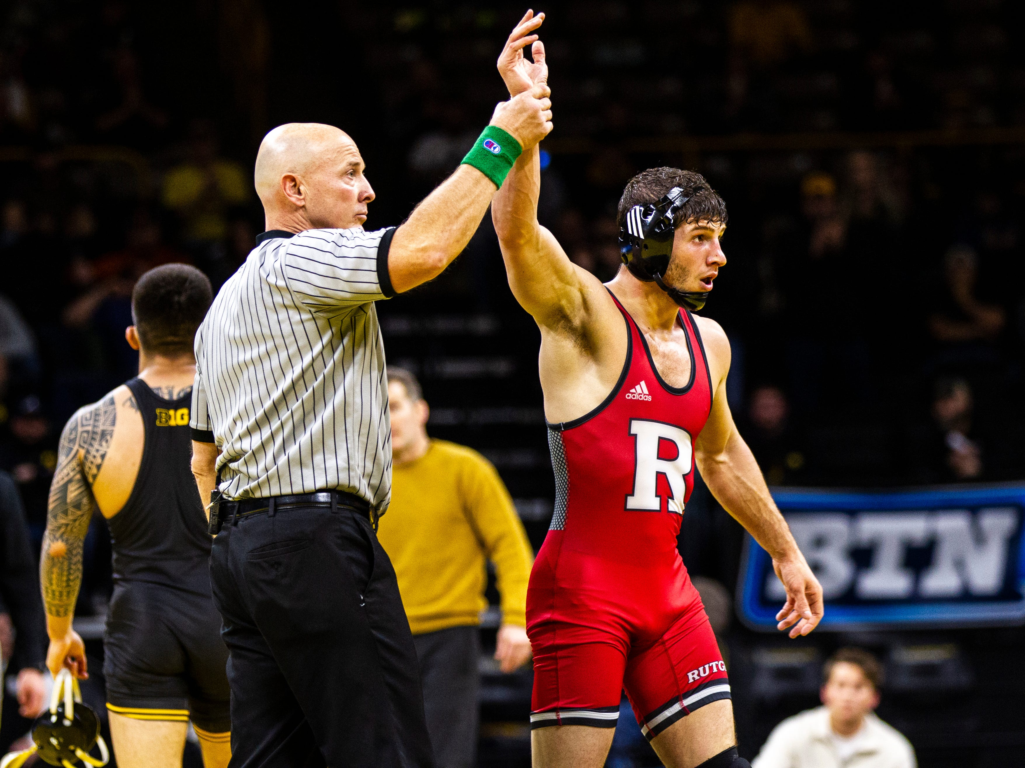 Rutgers' Anthony Ashnault has his arm raised after scoring a decision over Iowa's Pat Lugo  at 149 during a NCAA Big Ten Conference wrestling dual on Friday, Jan. 18, 2019, at Carver-Hawkeye Arena in Iowa City, Iowa.
