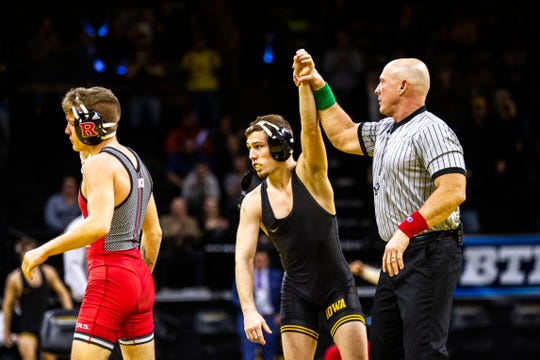Iowa's Spencer Lee has his hand raised after pinning Rutgers' Nick Denora at 125 during a NCAA Big Ten Conference wrestling dual on Friday, Jan. 18, 2019, at Carver-Hawkeye Arena in Iowa City, Iowa.