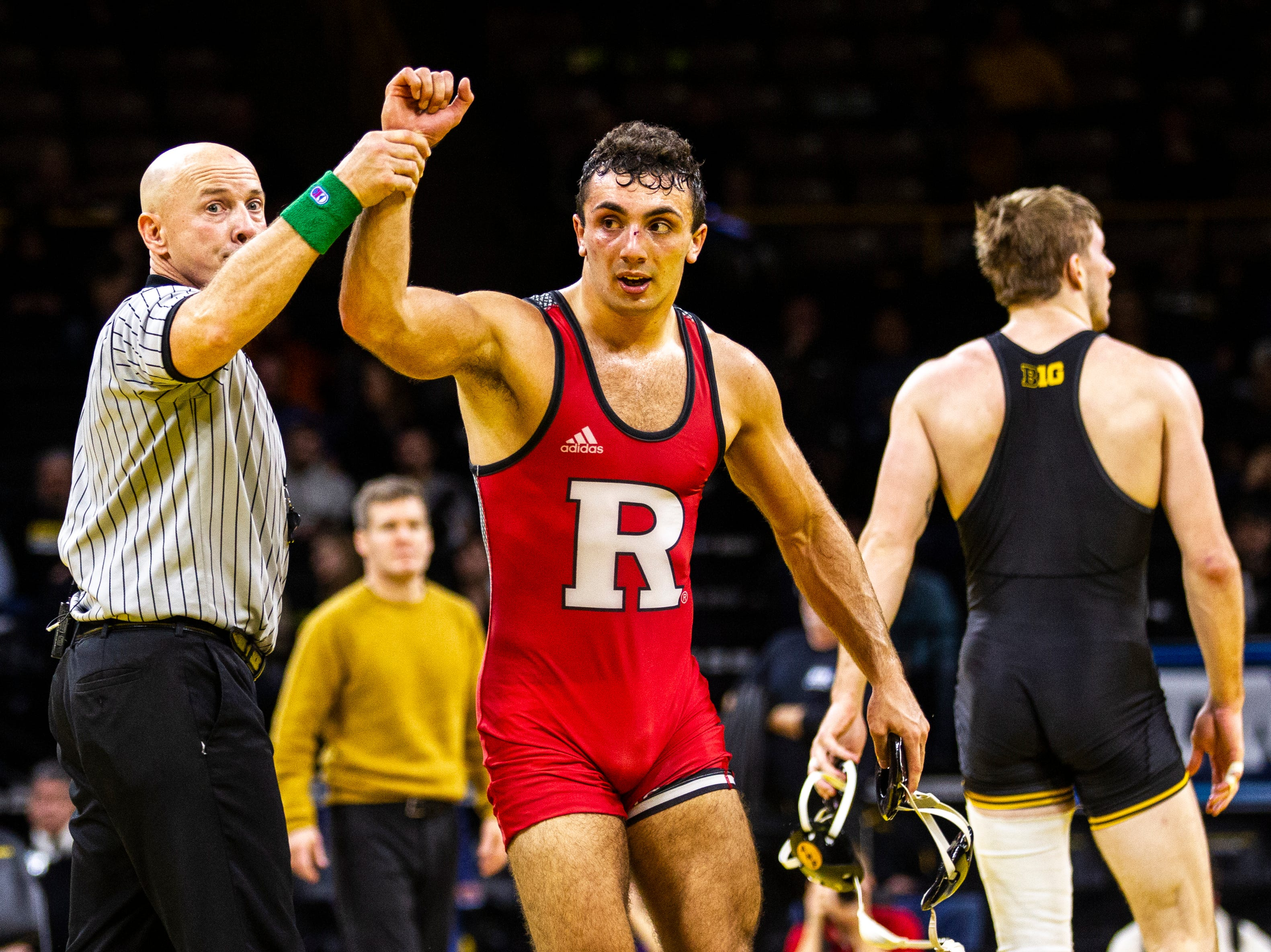 Rutgers' Joseph Grello has his hand raised after defeating Iowa's Mitch Bowman at 174 during a NCAA Big Ten Conference wrestling dual on Friday, Jan. 18, 2019, at Carver-Hawkeye Arena in Iowa City, Iowa.