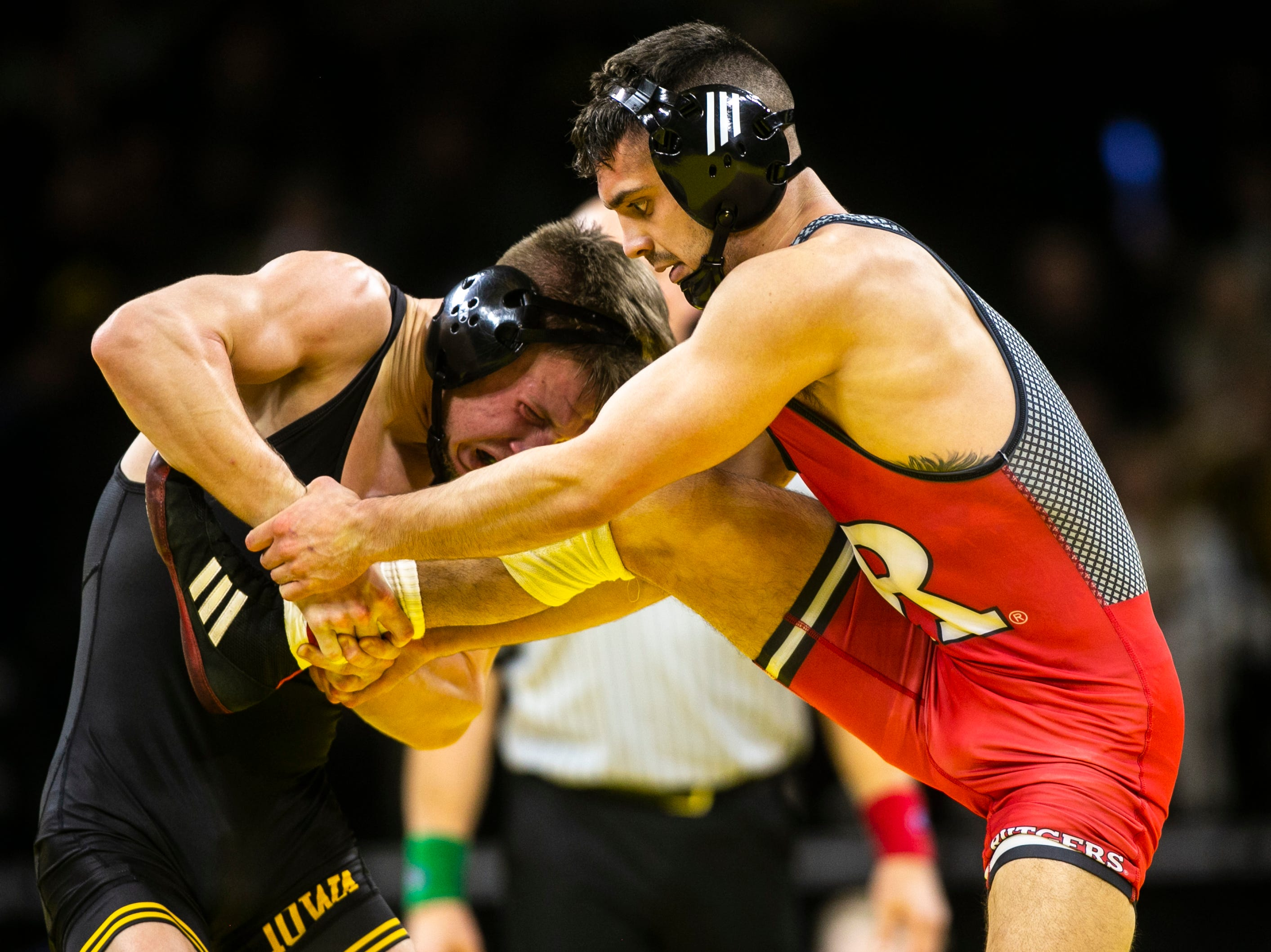 Iowa's Max Murin, left, wrestles Rutgers' Peter Lipari at 141 during a NCAA Big Ten Conference wrestling dual on Friday, Jan. 18, 2019, at Carver-Hawkeye Arena in Iowa City, Iowa.