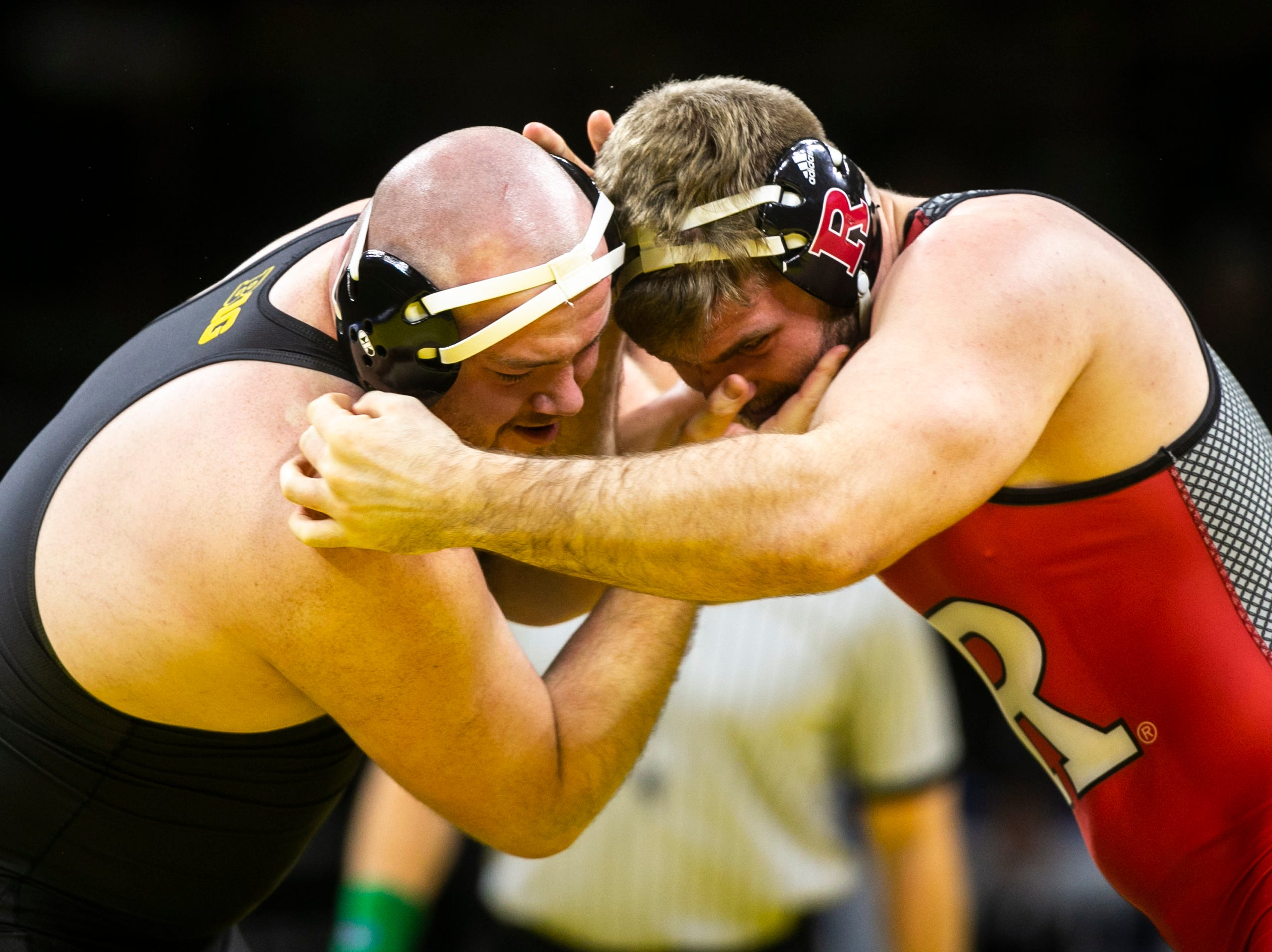 Iowa's Sam Stoll, left, wrestles Rutgers' Christian Colucci at 285 during a NCAA Big Ten Conference wrestling dual on Friday, Jan. 18, 2019, at Carver-Hawkeye Arena in Iowa City, Iowa.