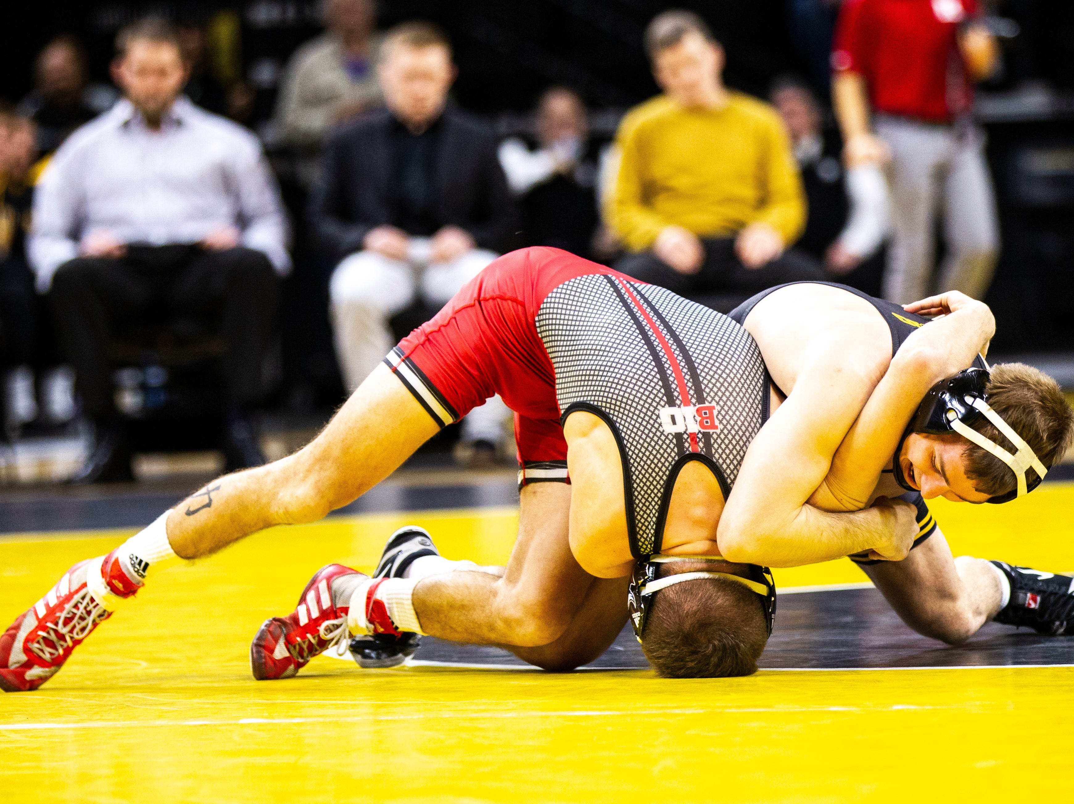 Iowa's Spencer Lee, right, wrestles Rutgers' Nick Denora at 125 during a NCAA Big Ten Conference wrestling dual on Friday, Jan. 18, 2019, at Carver-Hawkeye Arena in Iowa City, Iowa.