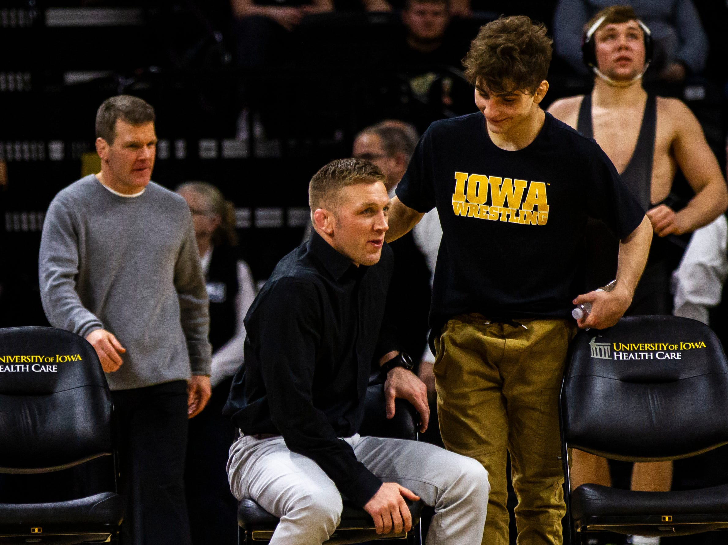 Iowa's Ryan Morningstar talks with Austin DeSanto during a NCAA Big Ten Conference wrestling dual on Friday, Jan. 18, 2019, at Carver-Hawkeye Arena in Iowa City, Iowa.