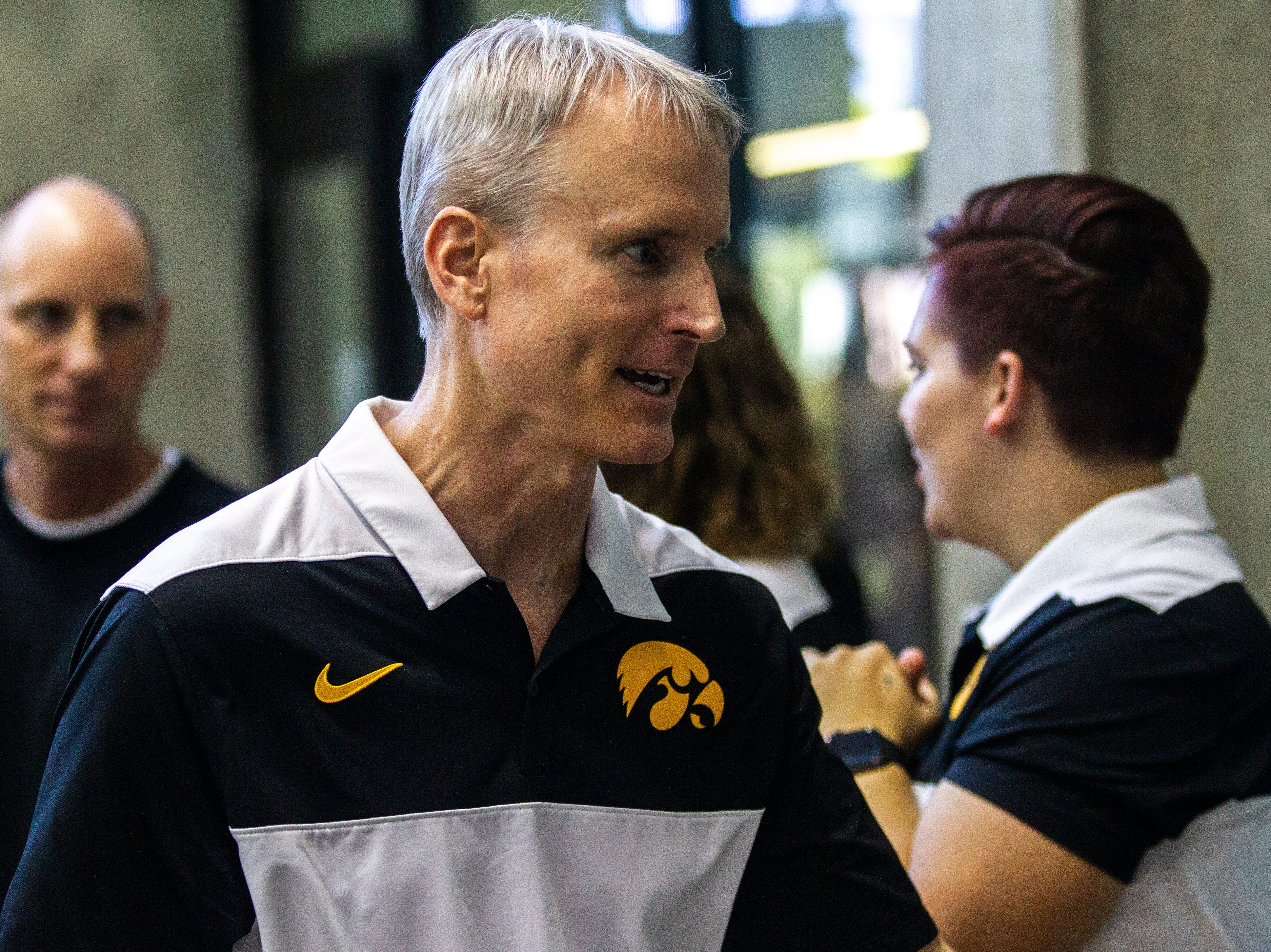 Iowa head coach Marc Long is seen during a NCAA Big Ten Conference swimming meet on Saturday, Jan. 19, 2019, at the Campus Recreation and Wellness Center in Iowa City, Iowa.