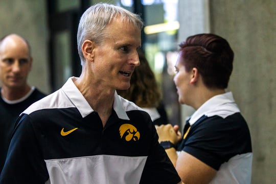 Iowa swimming and diving coach Marc Long, shown at the 2019 Big Ten Conference championships in Iowa City last year, is trying to keep his athletes focused after being told their program is on the chopping block.