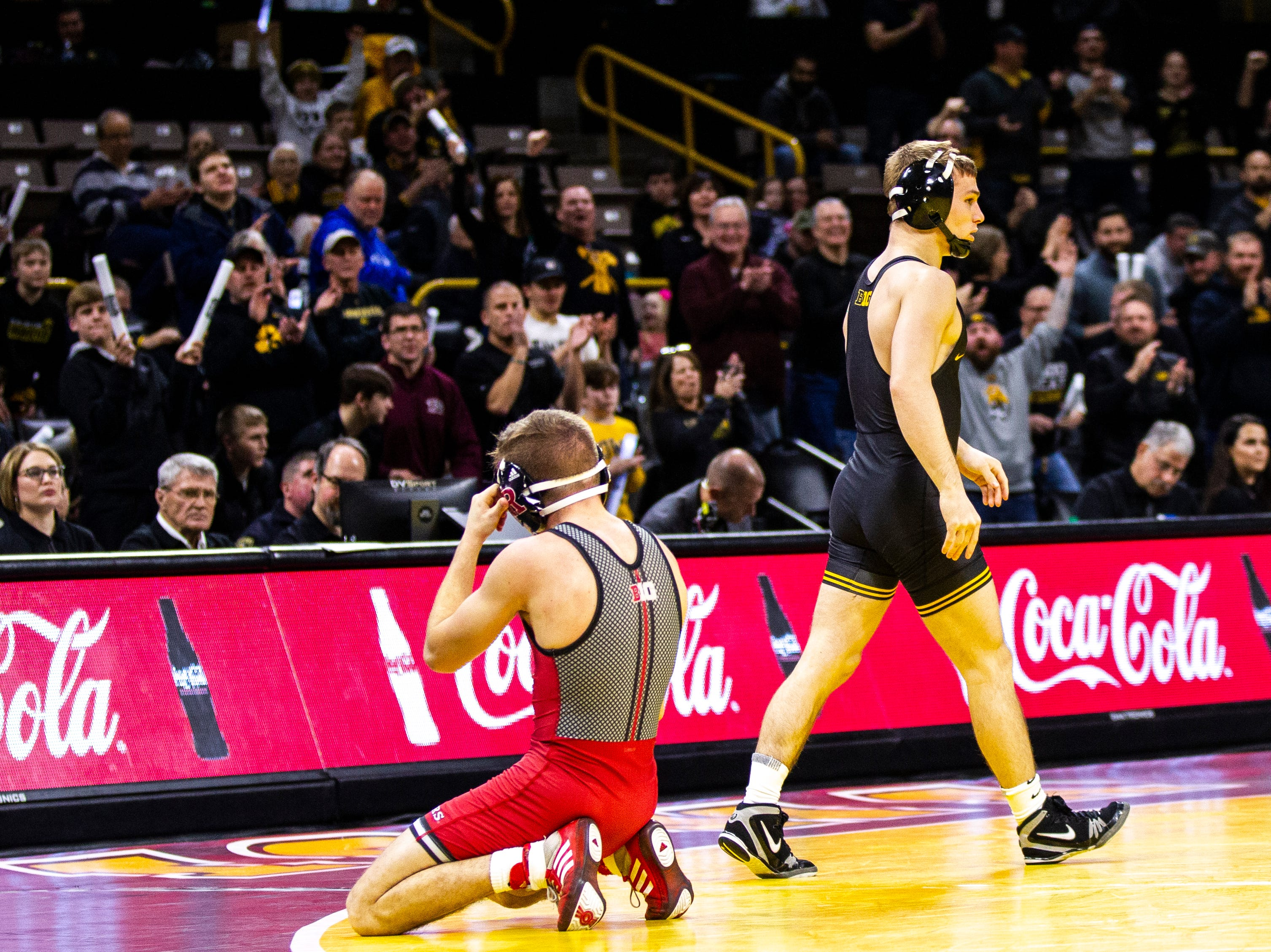 Iowa's Spencer Lee walks to the center of the mat after pinning Rutgers' Nick Denora at 125 during a NCAA Big Ten Conference wrestling dual on Friday, Jan. 18, 2019, at Carver-Hawkeye Arena in Iowa City, Iowa.