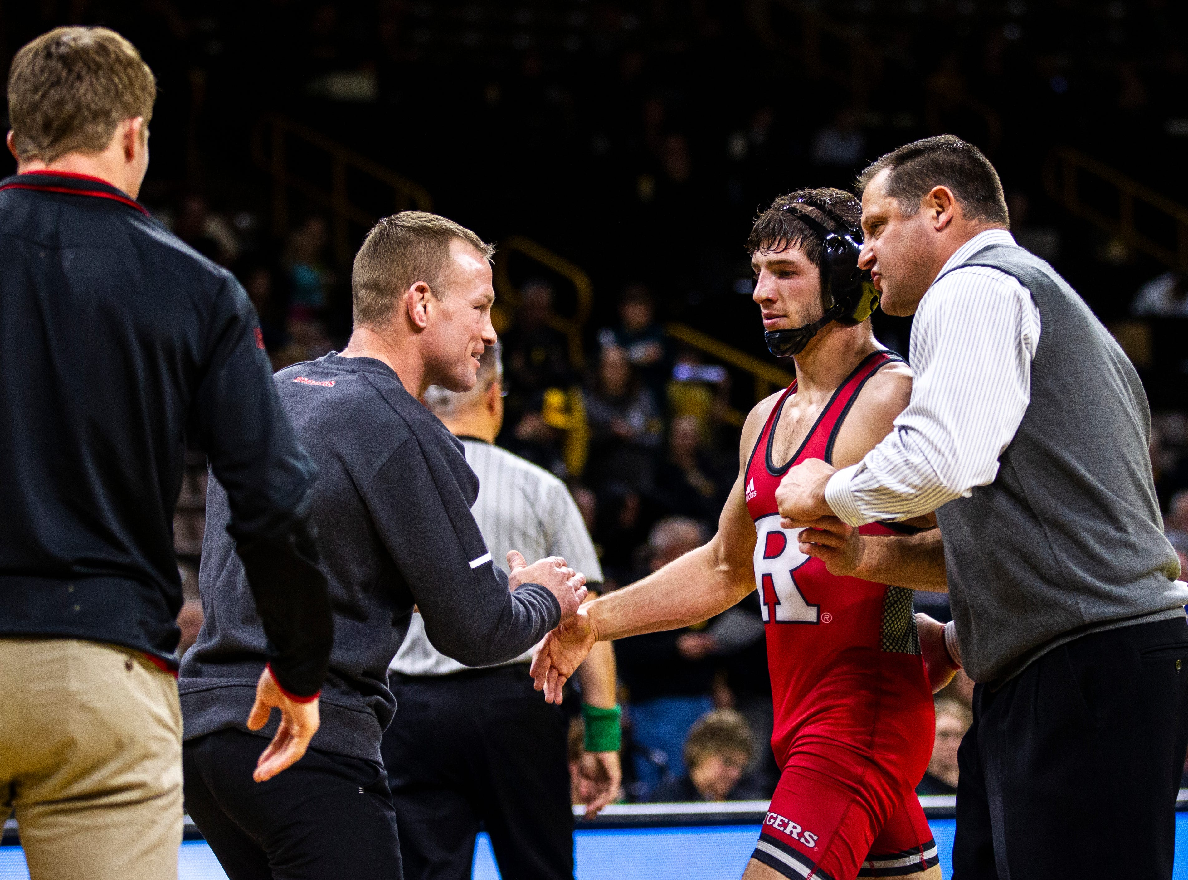 Rutgers' Anthony Ashnault is embraced by coaches during a NCAA Big Ten Conference wrestling dual on Friday, Jan. 18, 2019, at Carver-Hawkeye Arena in Iowa City, Iowa.