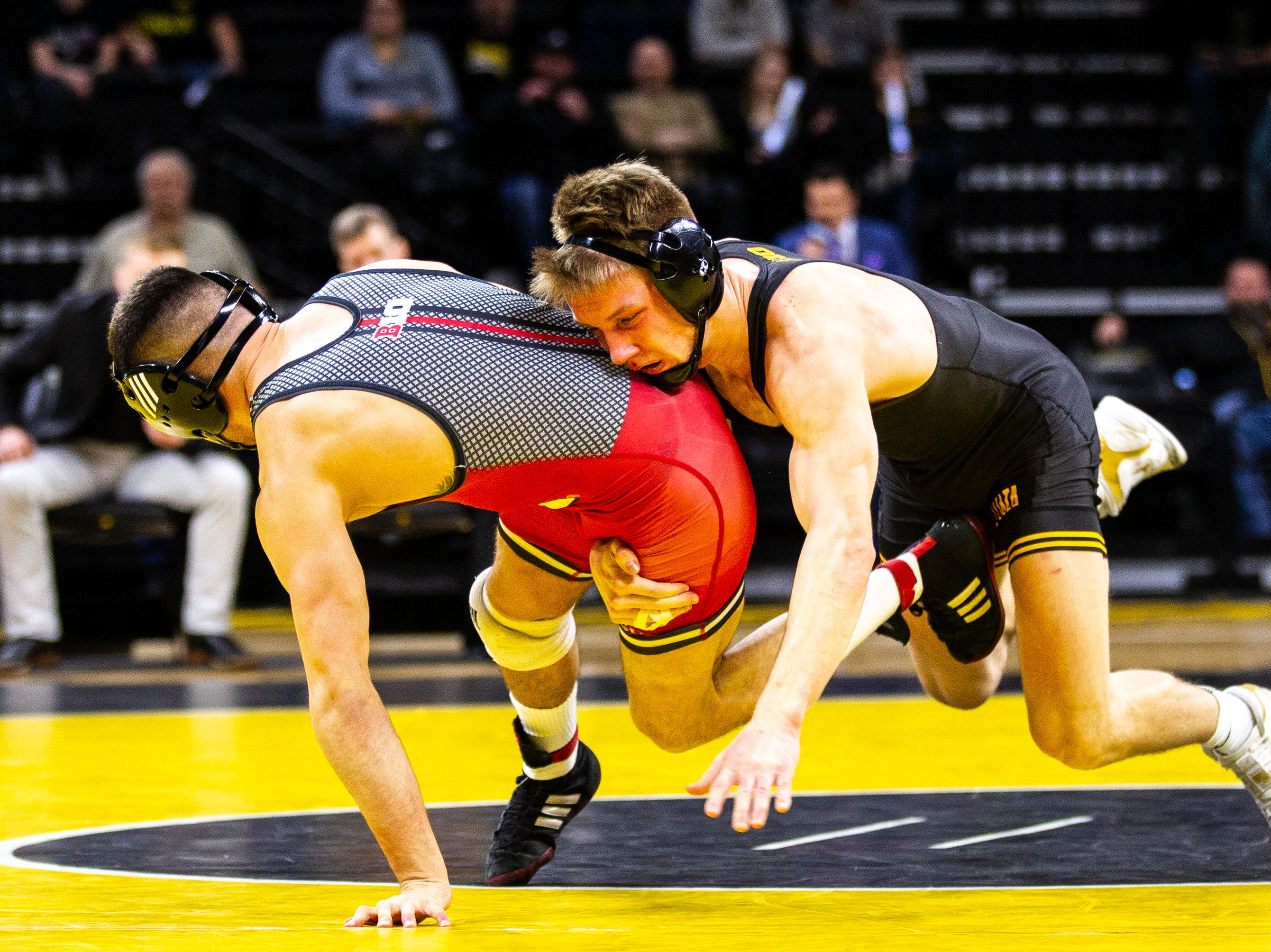 Iowa's Max Murin, right, wrestles Rutgers' Peter Lipari at 141 during a NCAA Big Ten Conference wrestling dual on Friday, Jan. 18, 2019, at Carver-Hawkeye Arena in Iowa City, Iowa.