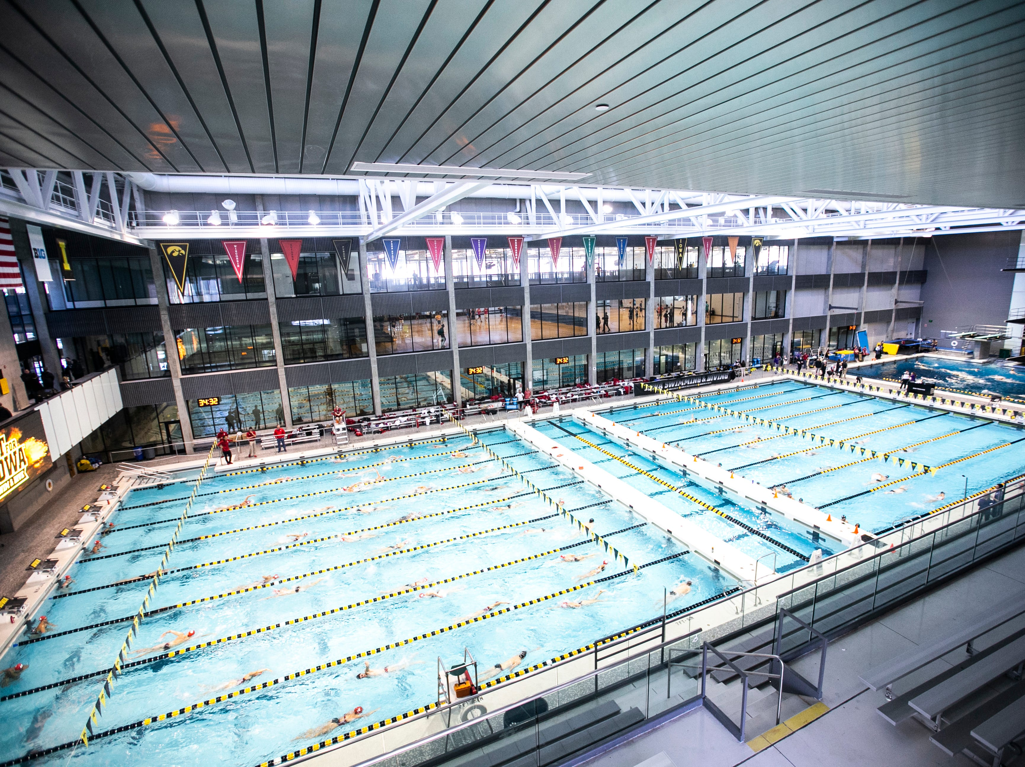 Swimmers cool down after a NCAA Big Ten Conference swimming meet on Saturday, Jan. 19, 2019, at the Campus Recreation and Wellness Center in Iowa City, Iowa.