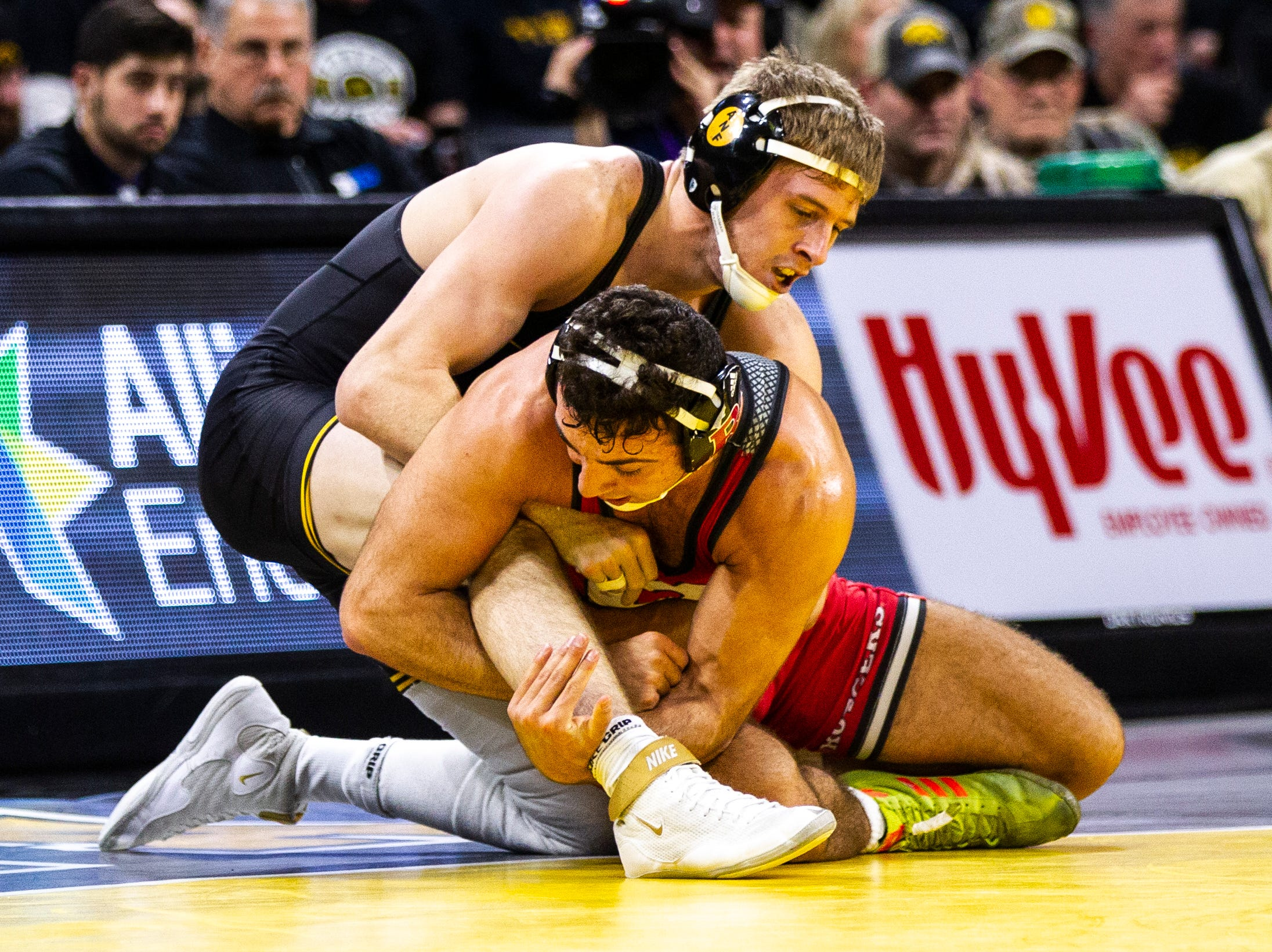 Iowa's Mitch Bowman, top, wrestles Rutgers' Joseph Grello at 174 during a NCAA Big Ten Conference wrestling dual on Friday, Jan. 18, 2019, at Carver-Hawkeye Arena in Iowa City, Iowa.
