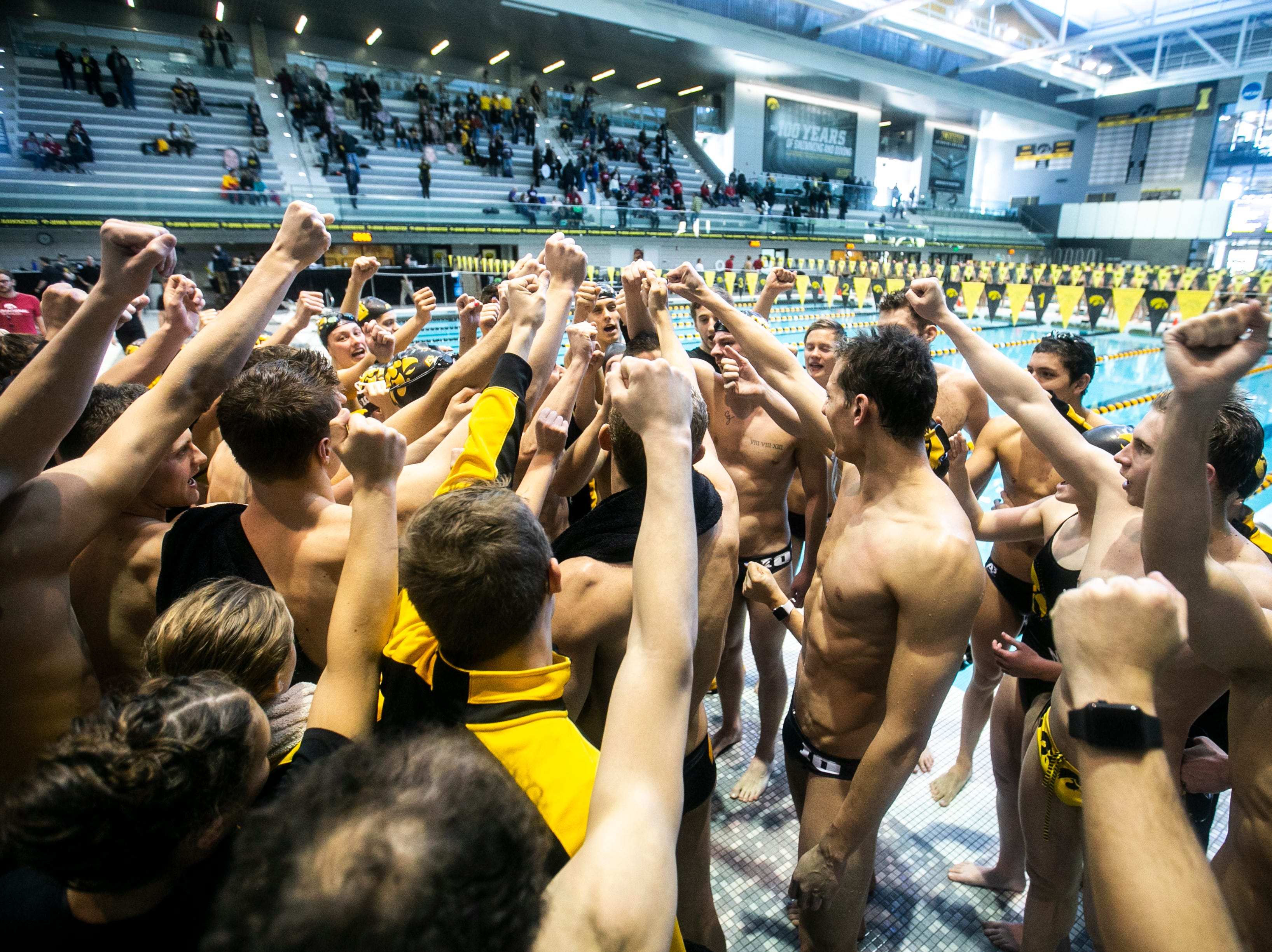 Iowa Hawkeyes huddle up after a NCAA Big Ten Conference swimming meet on Saturday, Jan. 19, 2019, at the Campus Recreation and Wellness Center in Iowa City, Iowa.