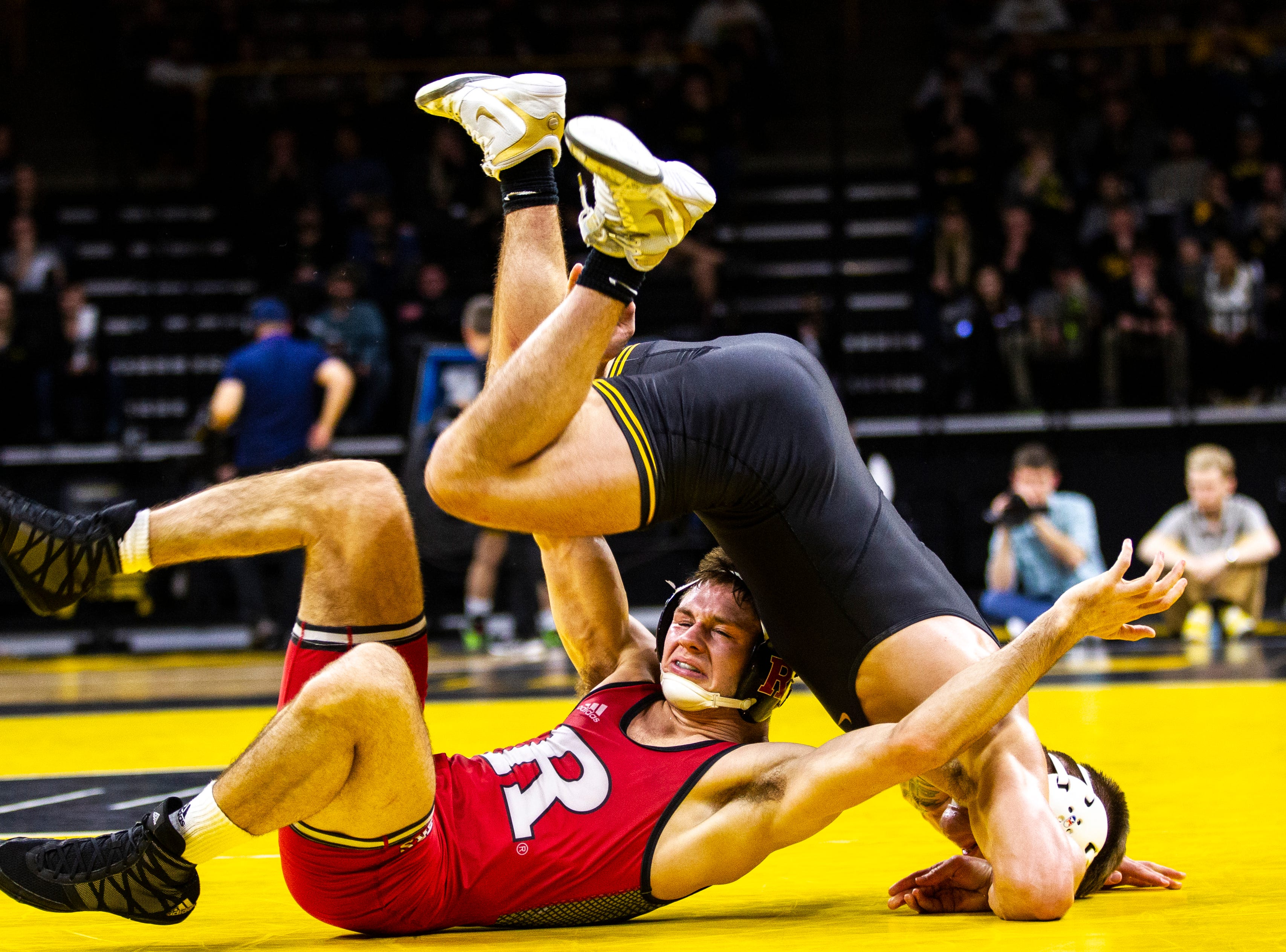 Iowa's Cash Wilcke, right, wrestles Rutgers' Willie Scott at 184 during a NCAA Big Ten Conference wrestling dual on Friday, Jan. 18, 2019, at Carver-Hawkeye Arena in Iowa City, Iowa.