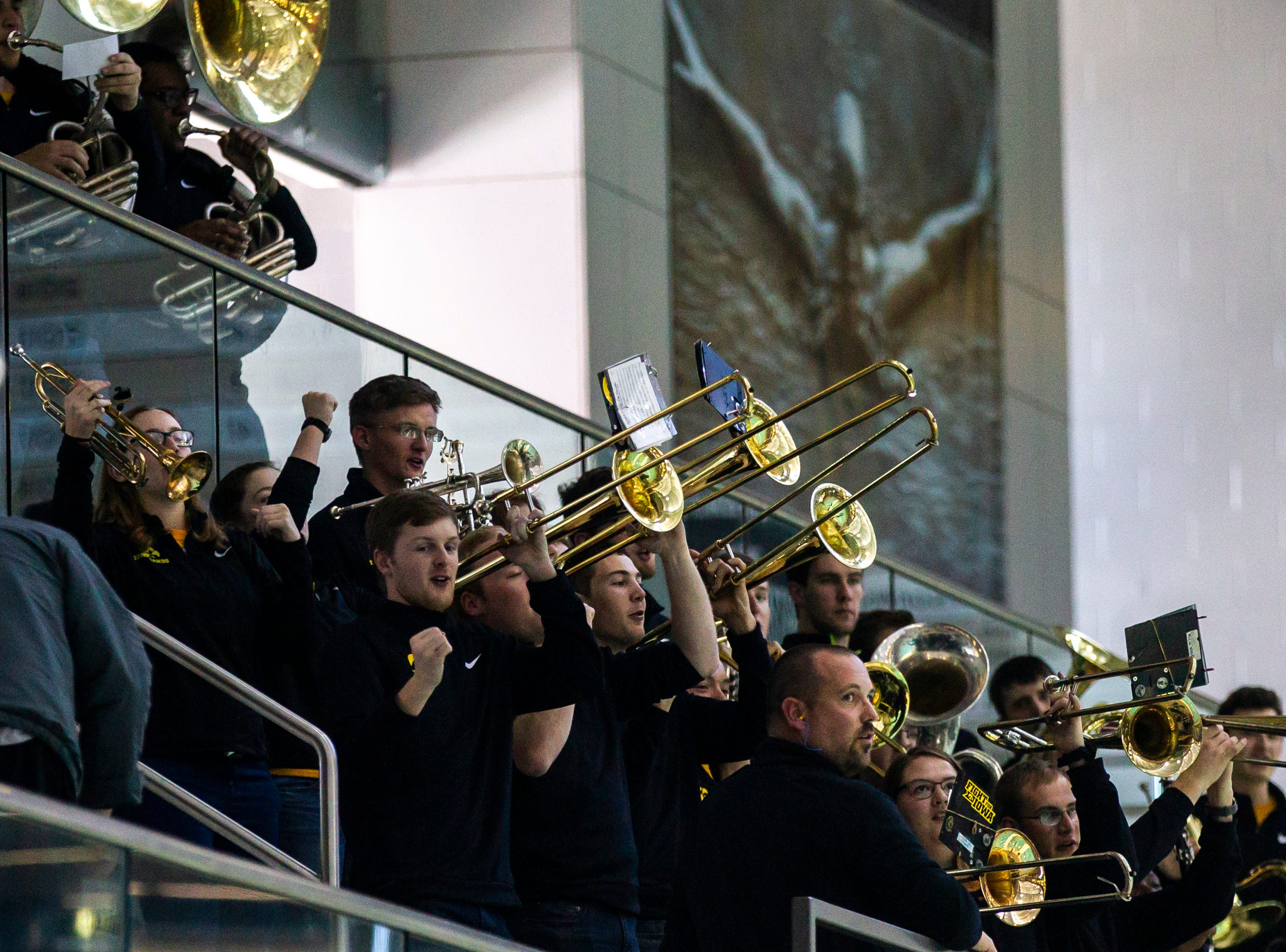 Members of the Iowa pep band perform during a NCAA Big Ten Conference swimming meet on Saturday, Jan. 19, 2019, at the Campus Recreation and Wellness Center in Iowa City, Iowa.