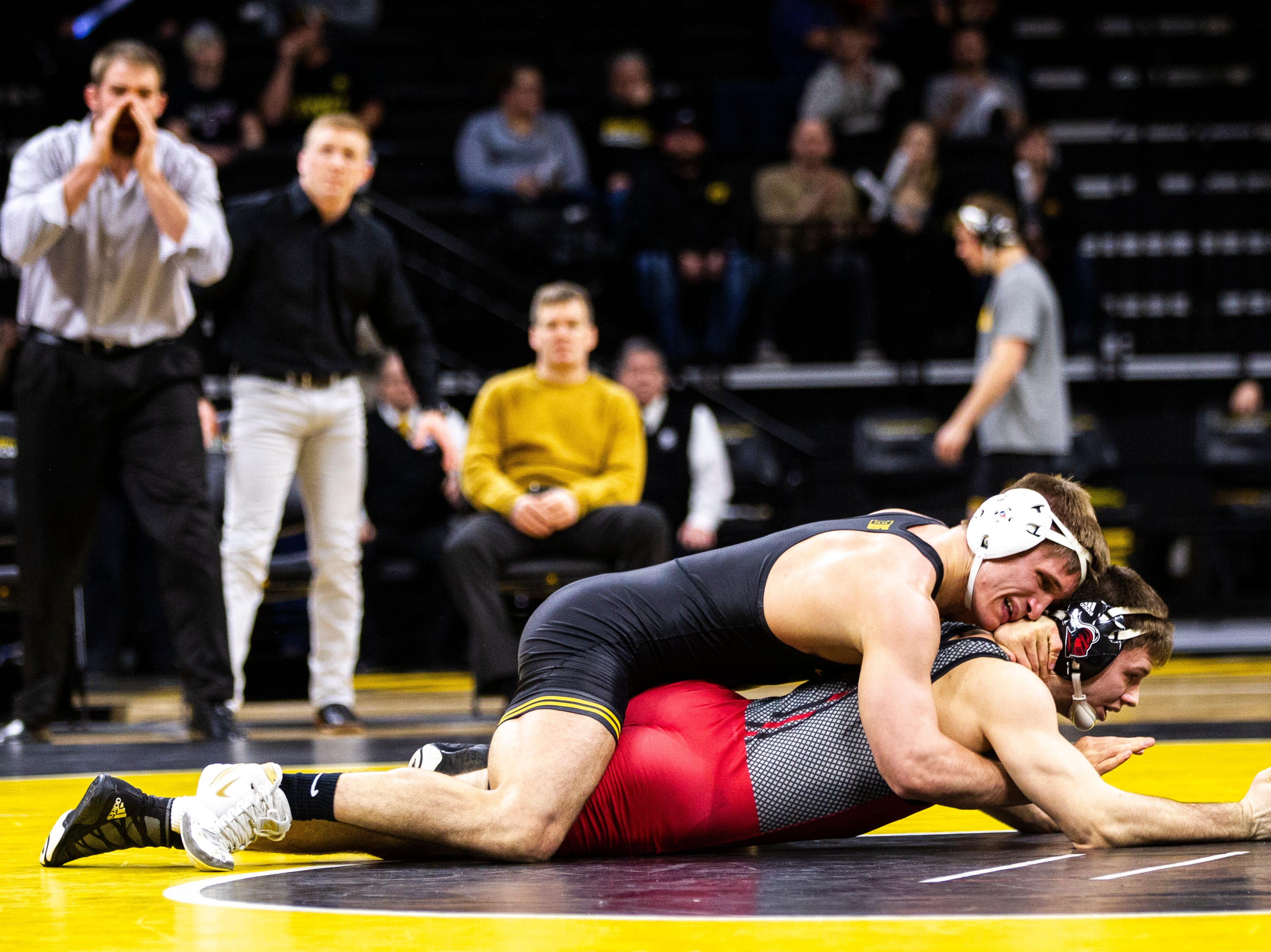 Iowa's Cash Wilcke, top, wrestles Rutgers' Willie Scott at 184 during a NCAA Big Ten Conference wrestling dual on Friday, Jan. 18, 2019, at Carver-Hawkeye Arena in Iowa City, Iowa.