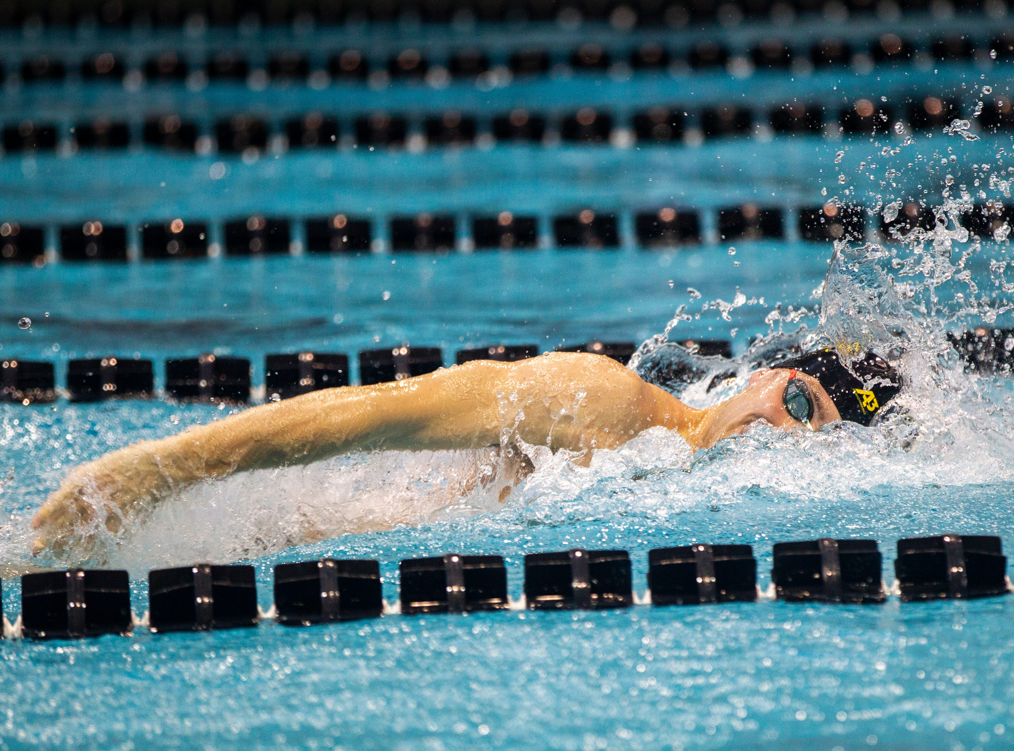 Iowa senior Jack Smith finishes the final stretch of the 400 yard freestyle relay during a NCAA Big Ten Conference swimming meet on Saturday, Jan. 19, 2019, at the Campus Recreation and Wellness Center in Iowa City, Iowa. Smith brought in the win with a final time of 2:57.41.