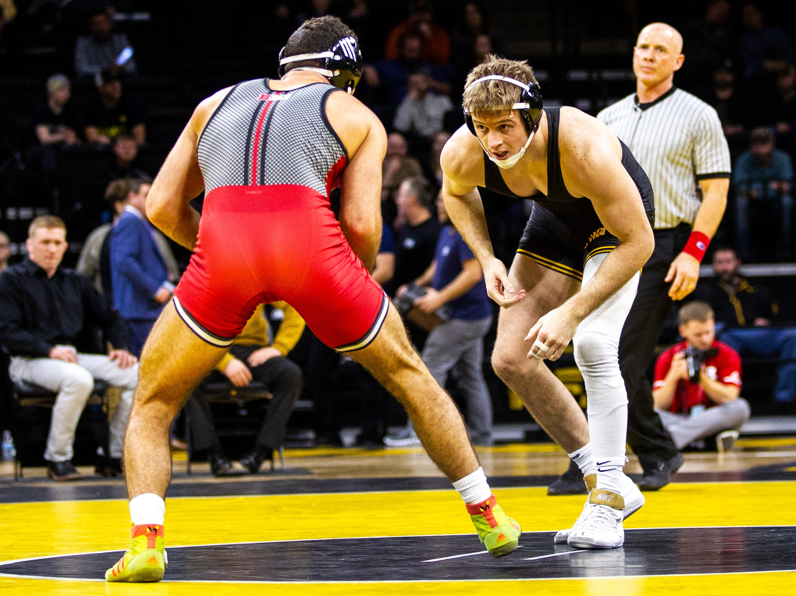 Iowa's Mitch Bowman, right, wrestles Rutgers' Joseph Grello at 174 during a NCAA Big Ten Conference wrestling dual on Friday, Jan. 18, 2019, at Carver-Hawkeye Arena in Iowa City, Iowa.